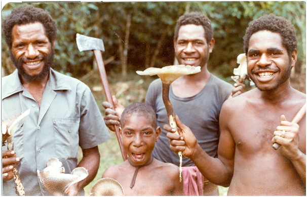 Paulus Pai Paul Koj picking mushrooms at Kailge (1980)