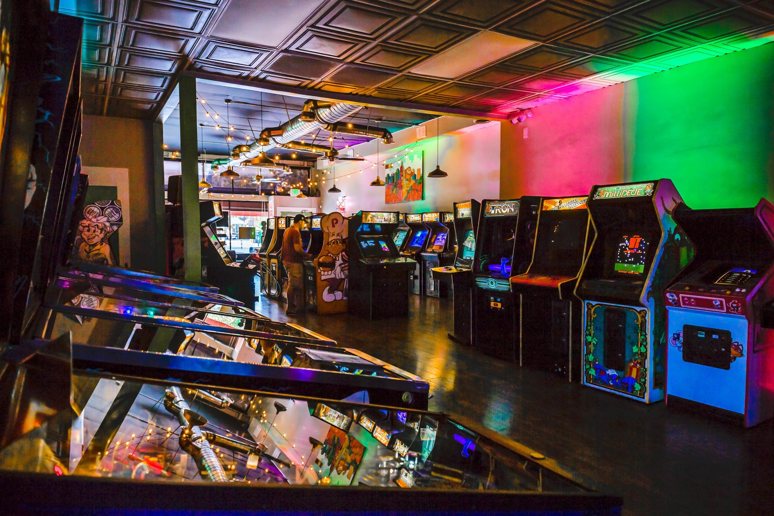 arcade with neon lights, games