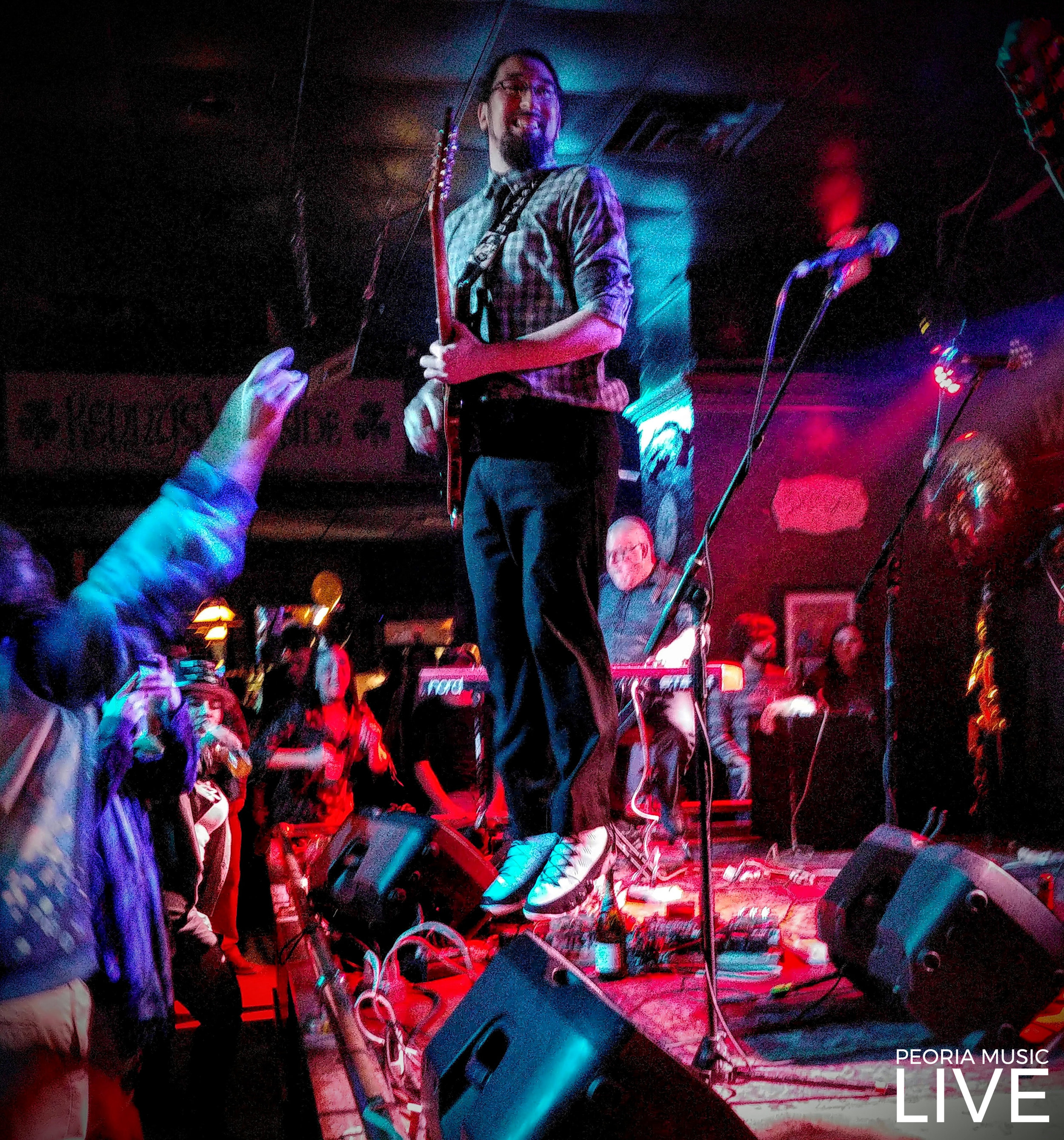 Roy Ponce of Brainchild. What most people see is the fact that he is flying, but someone pointed out how big his smile is and that's what I see when I look at this now. That's the smile of someone doing what they were born to do. At Kenny's Westside Pub 01/01/2019