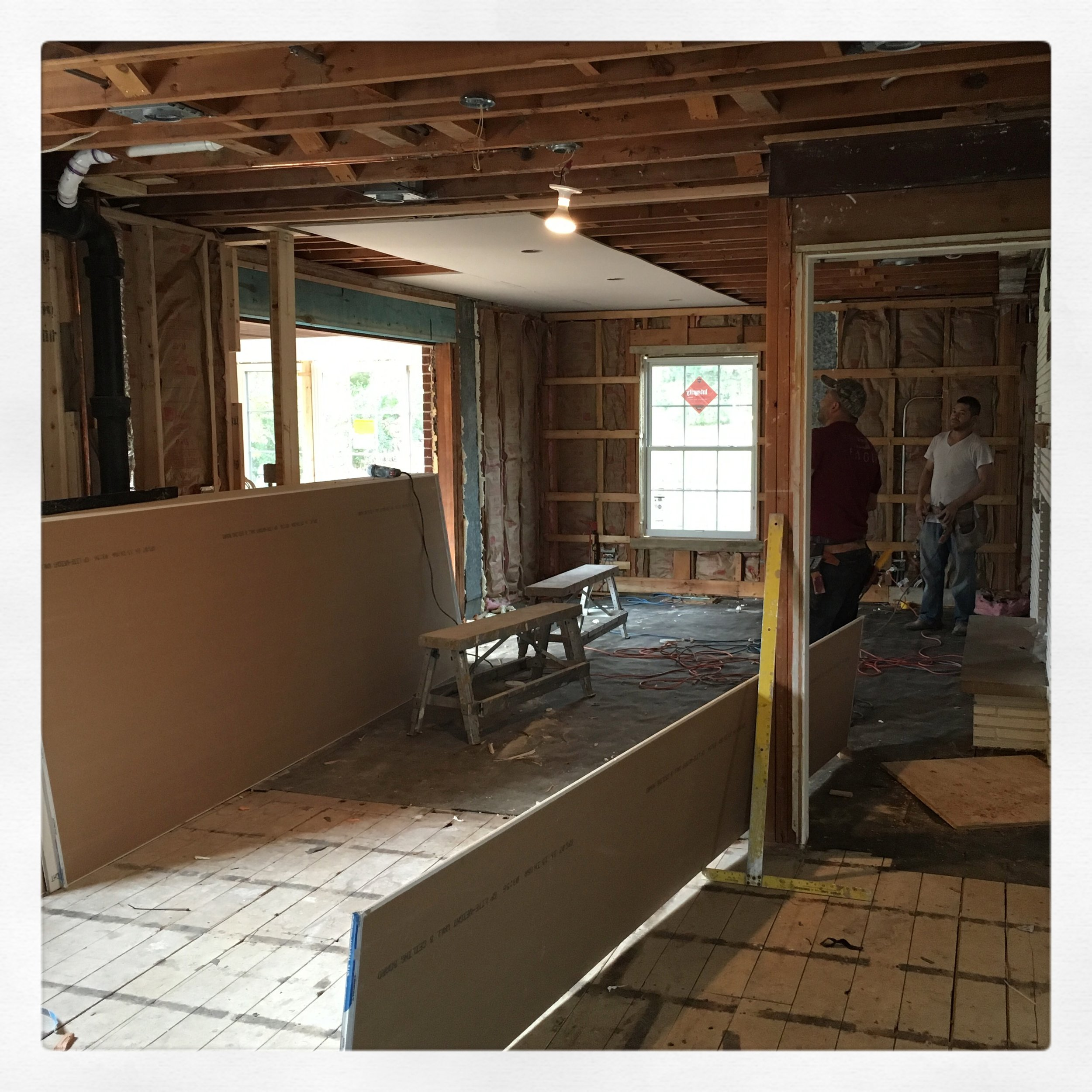 Once all existing HVAC was insulated in exterior walls new structural lintels were added at family room and dining room openings; plumbing was roughed in and modified to meet code; and electrical was roughed in with a freshly added sub panel, it was time for DRYWALL!!