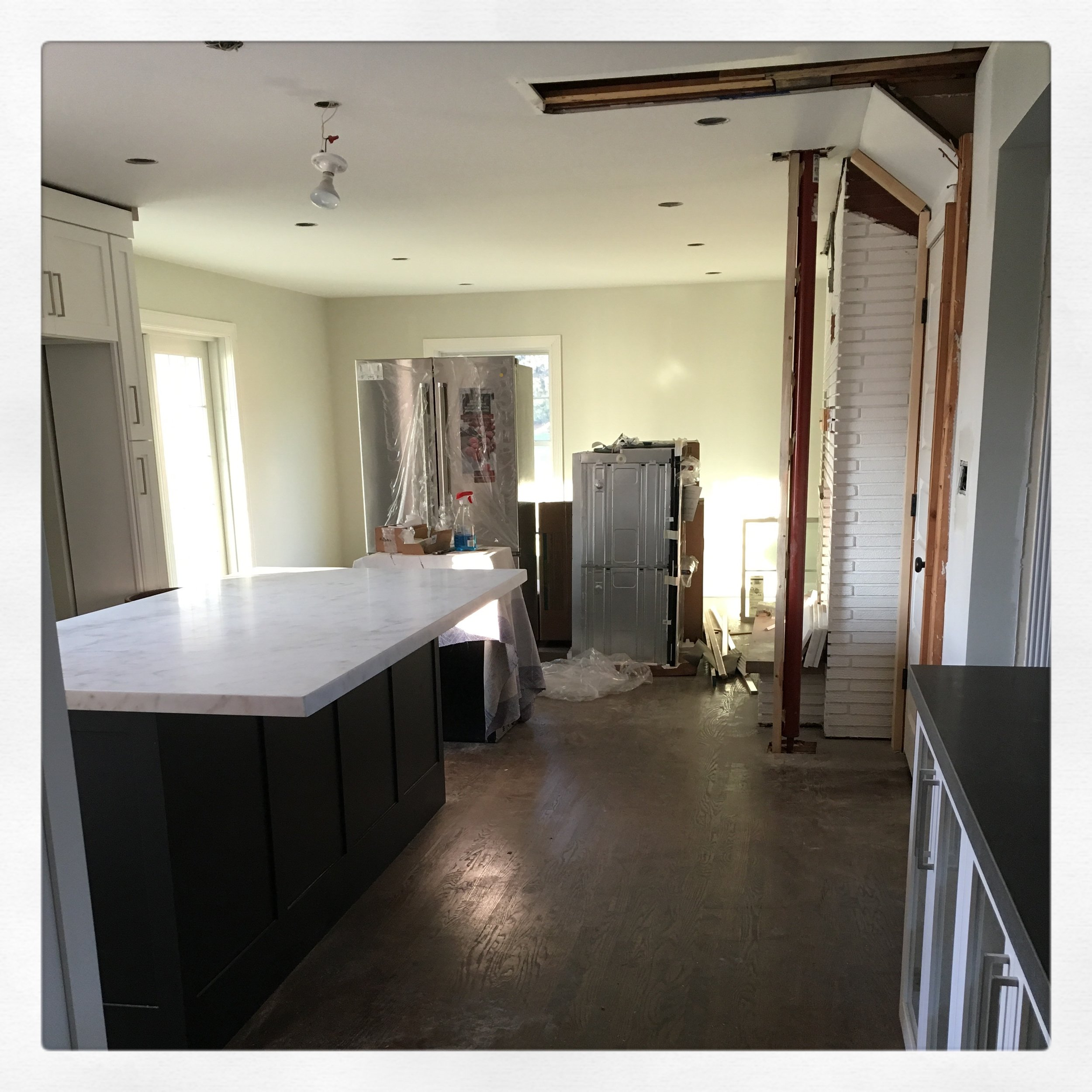 "Our marble countertops were measured and installed with a 15"" overhang for stools; appliances were delivered; painting was completed, and that bane of our existence structural doorway condition was still staring us in the face."