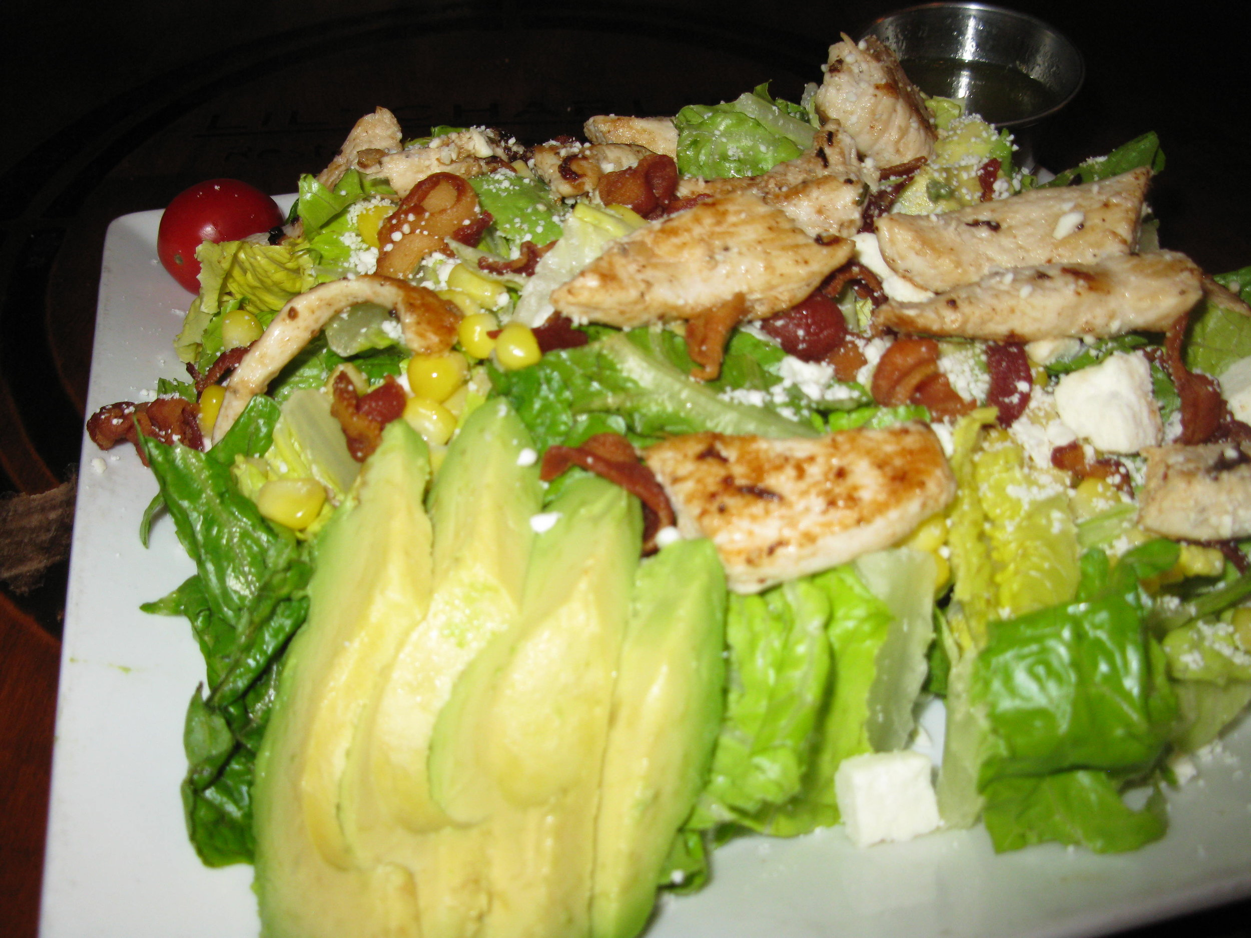 LC's Summer Salad - Fresh avocado, grilled chicken, feta cheese, crispy bacon, and corn over our refreshing romaine lettuce blend.  Served with a house made lime vinaigrette.