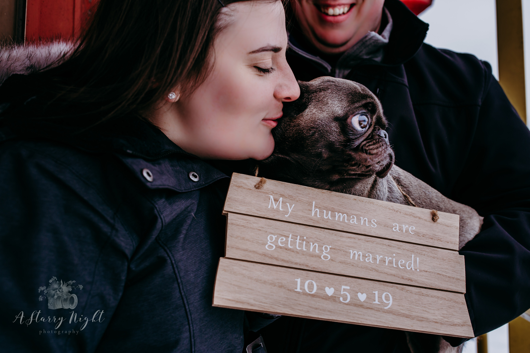 Couple with their Pug during their Engagement Session at the Clare, MI Train Depot.