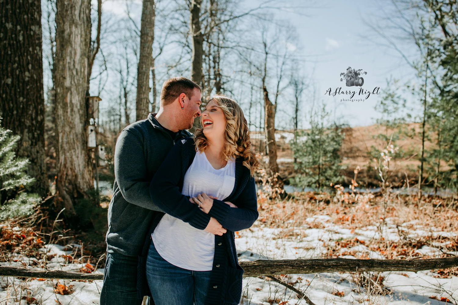 Engaged couple laughing during their photography session near the Dow Gardens in Midland, MI.