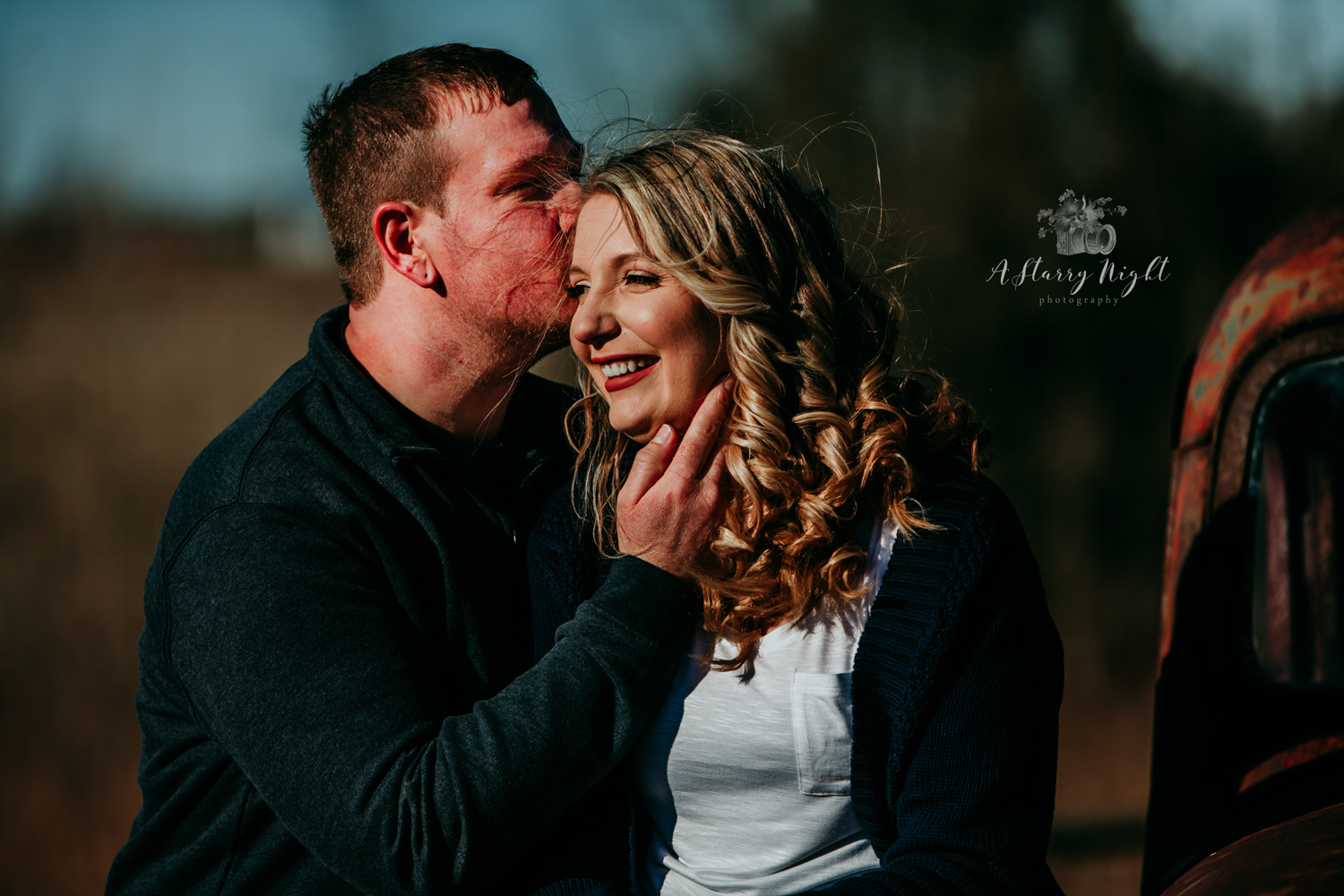 Soon to be groom kissing his fiance during their engagement session at Crooked River Weddings