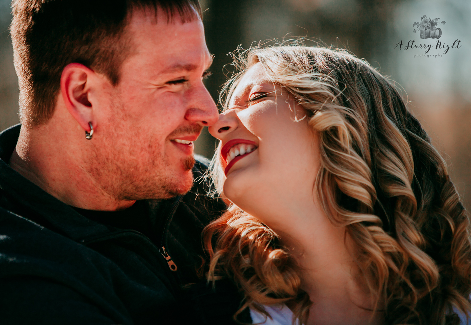Couple almost kissing during their couples session in Beaverton, MI