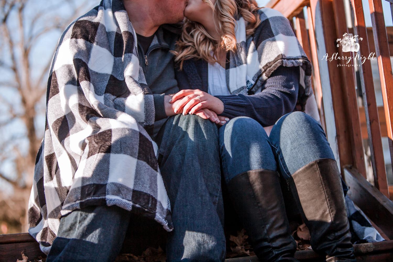 Couple kissing on the stairs in Beaverton near Midland, MI.