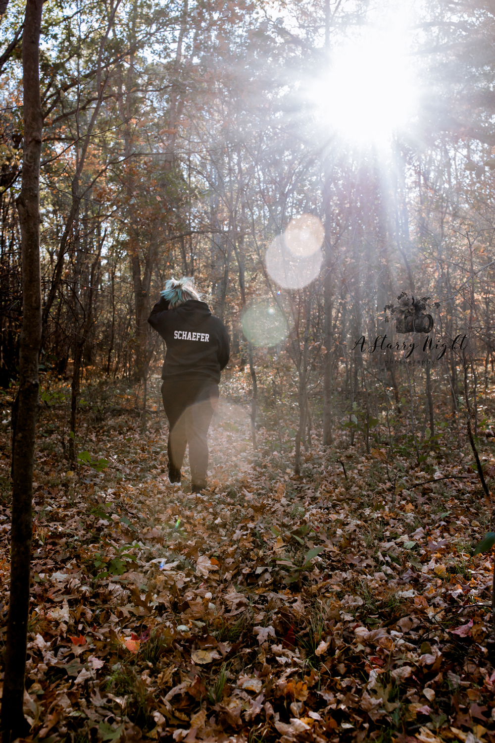 Senior girl walking through the woods in Farwell at A Starry Night Photography's studio in the Fall time.
