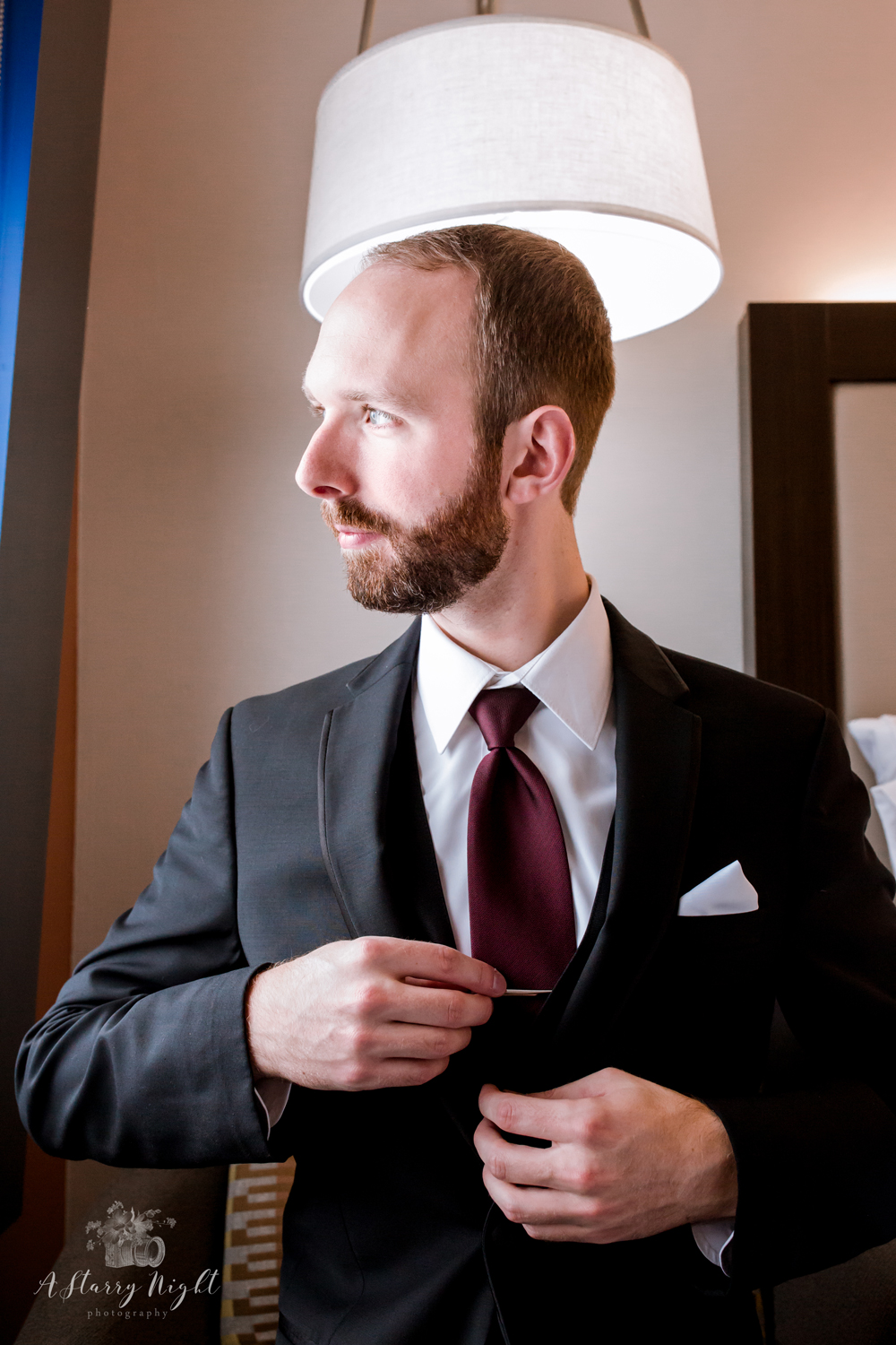 groom-adjusting-tie-holiday-inn-birch-run-mi.jpg