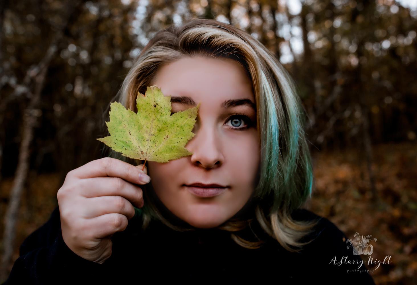 graduation-senior-portraits-autum-leaves.jpg