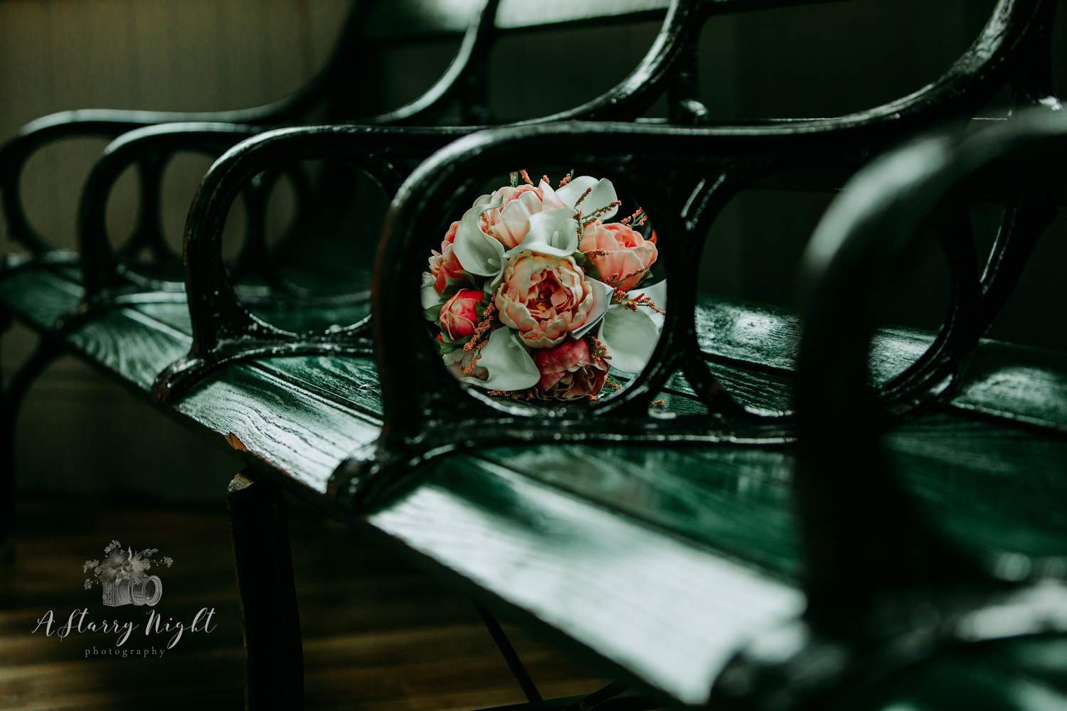 Shooting the bride's bouquet through the green bench at the Train Station