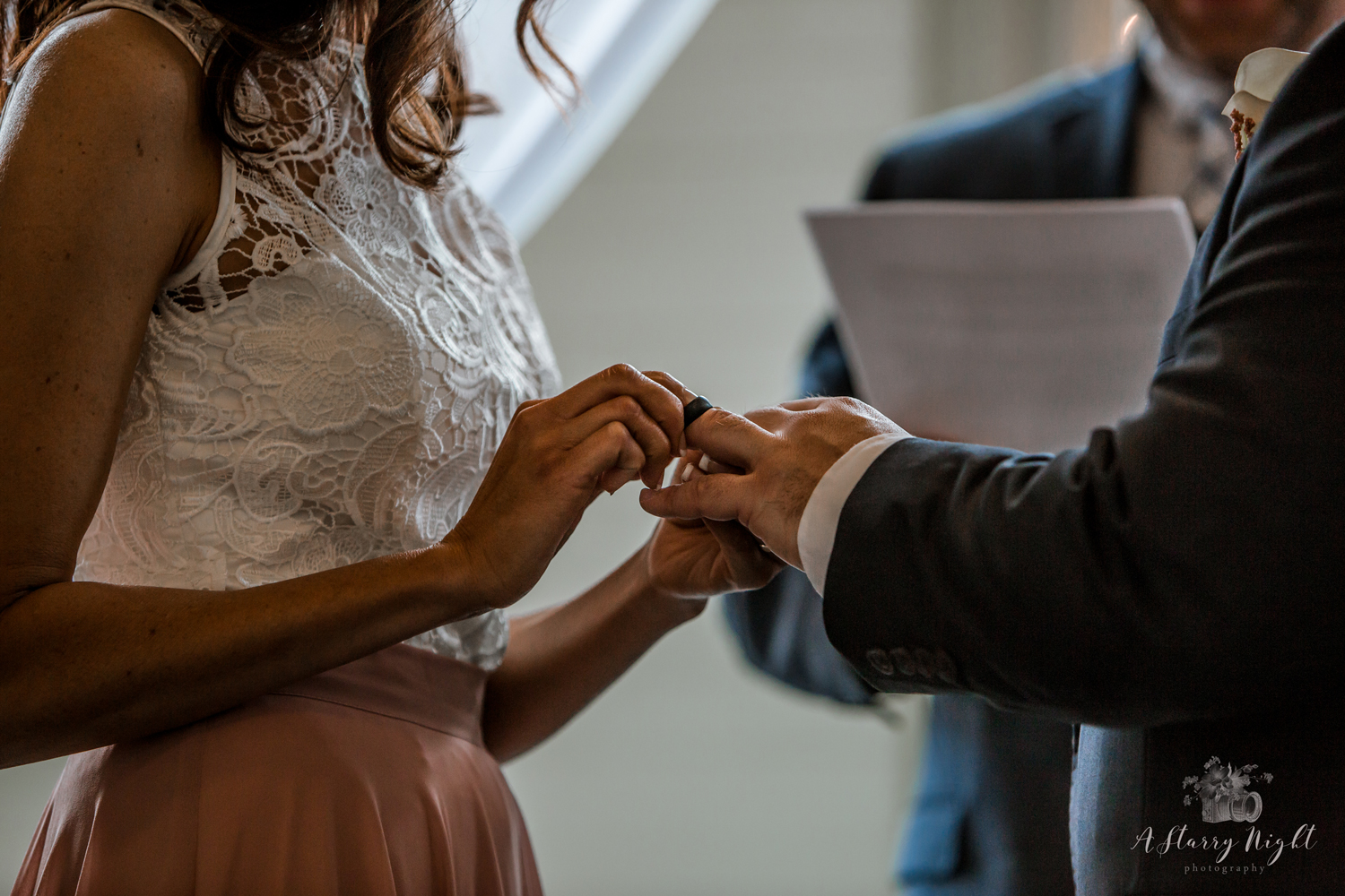Couple exchanging wedding rings during their ceremony.