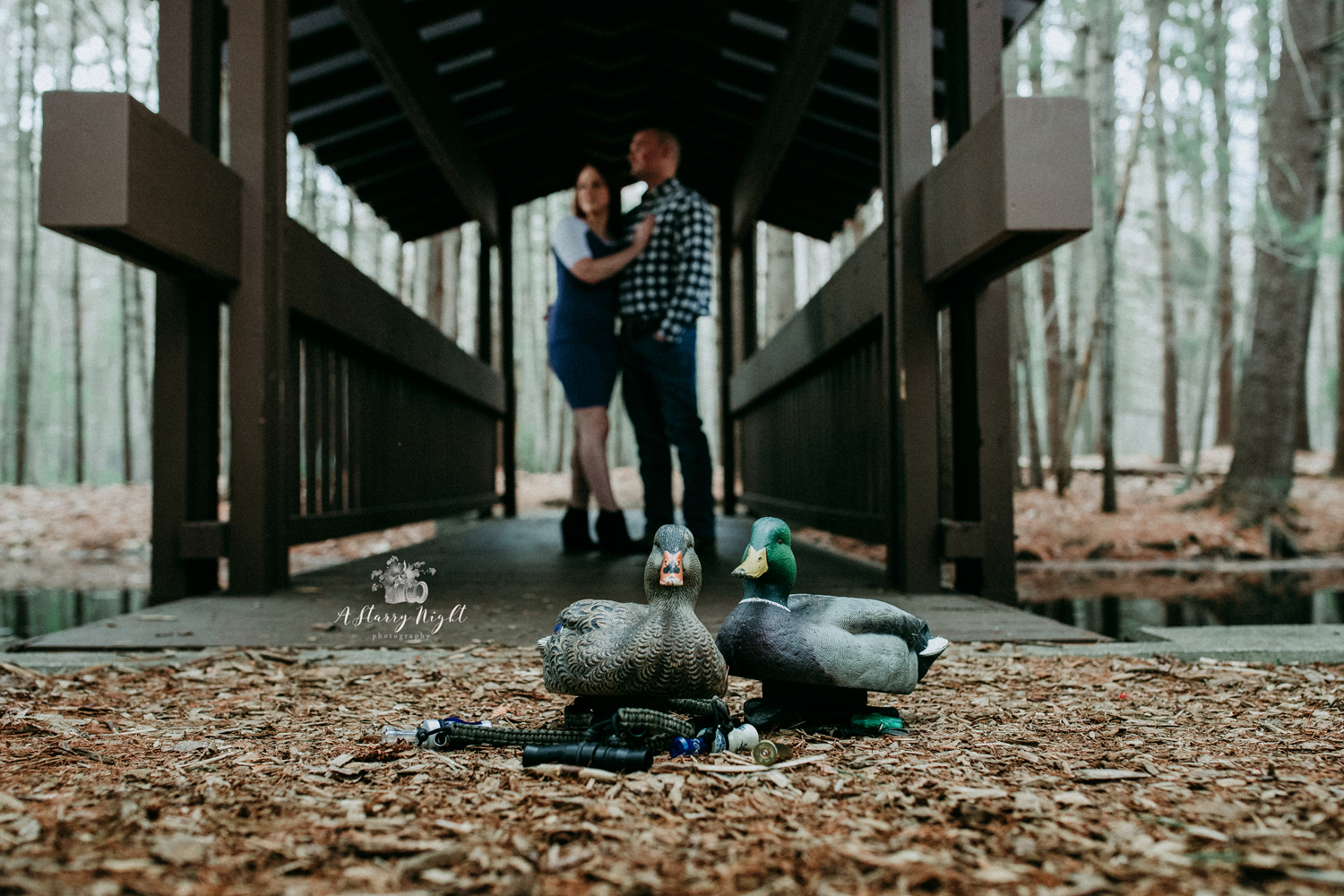 Engaged couple with their duck hunting decoys