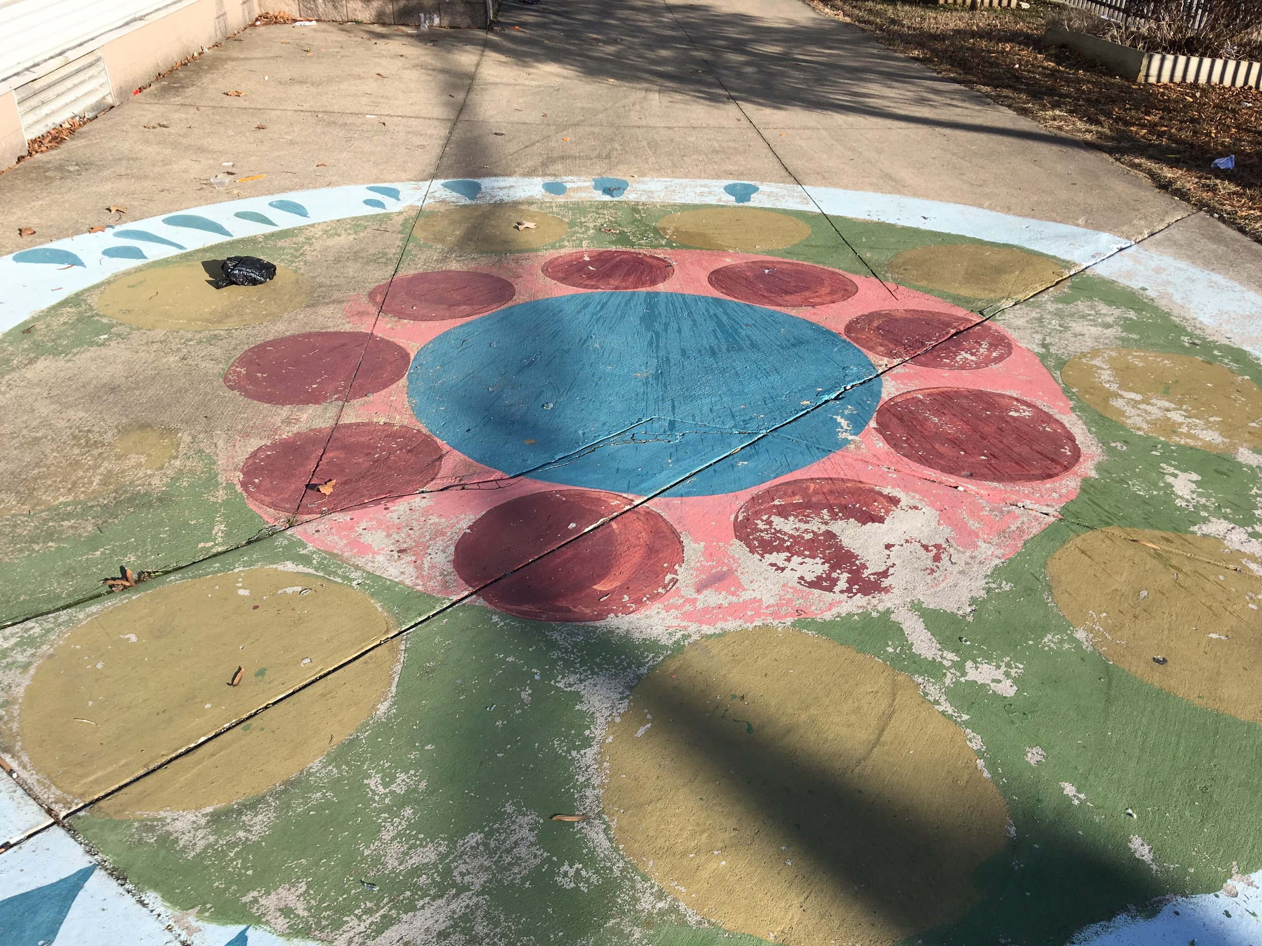 A ground mural in the playground area
