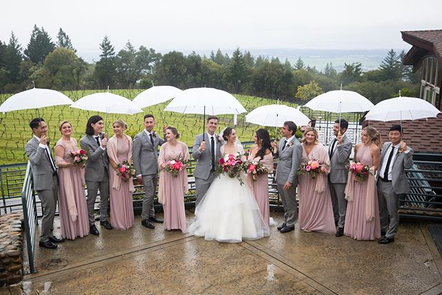 Rain on your wedding? No problem with your crew by your side ☔️ #rainyweddingday #thomasfogartywinery #thomasfogartywedding