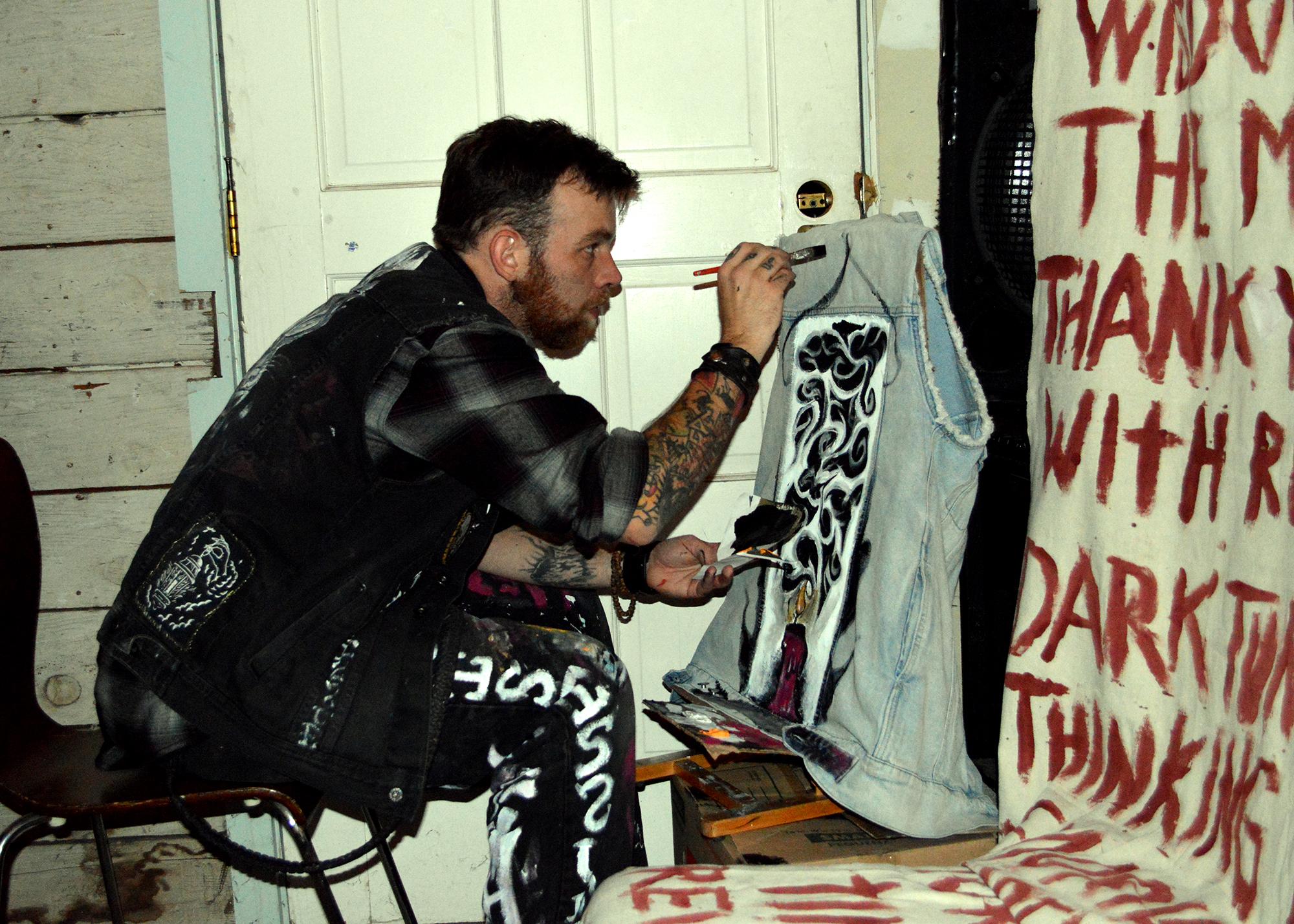 Colt  live painting a vest!