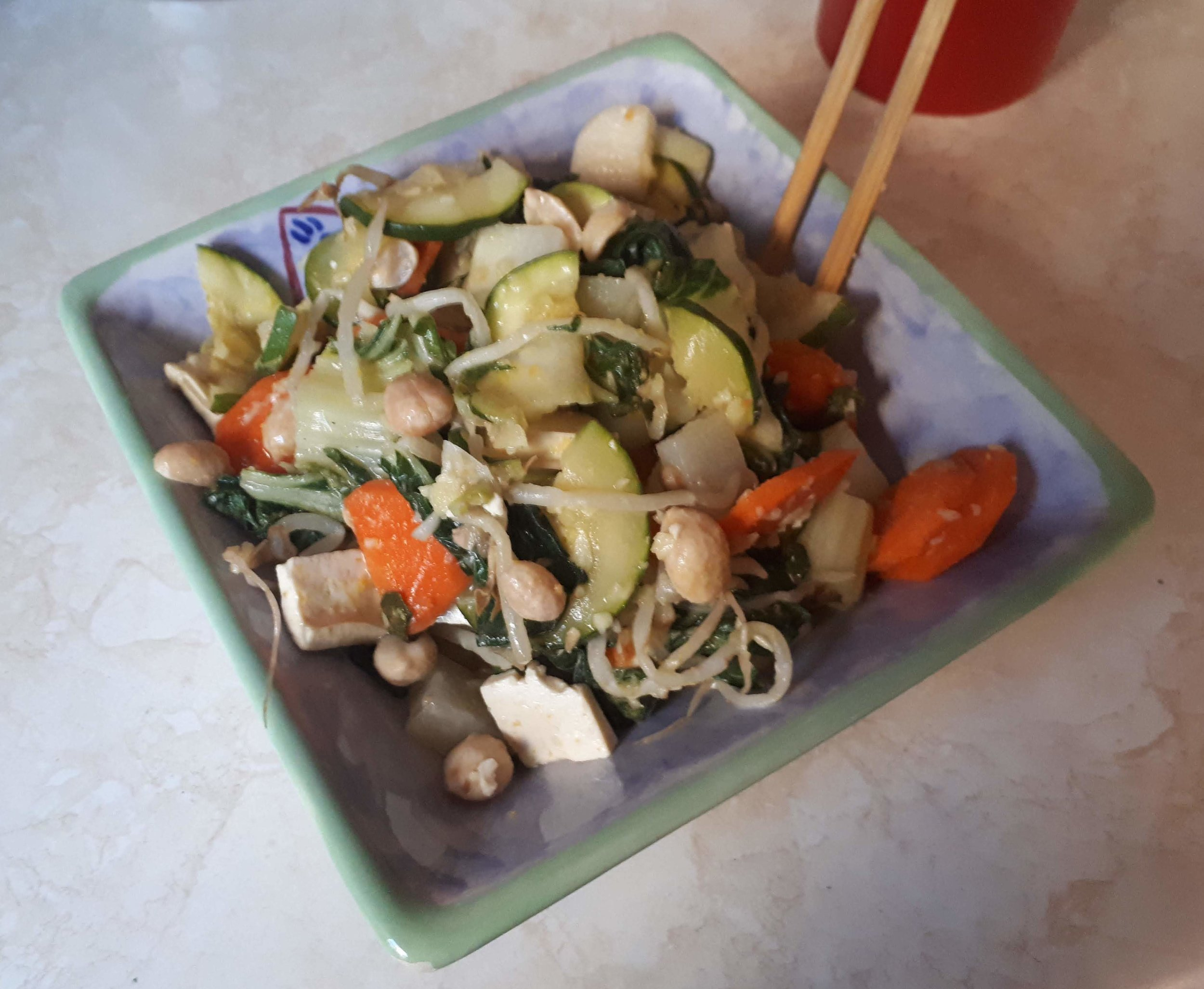 Stir fry. Bok choi, carrots, zucchini, kohlrabi, and bean sprouts with firm tofu and peanuts for protein and fat. Flavoured with ginger, salt, and sesame oil.