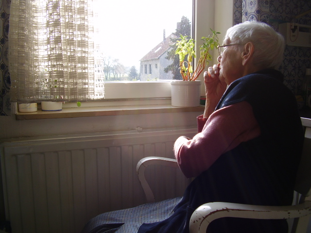 """There are many different health and social factors that can increase the risk of social isolation. Social isolation can increase certain health risks, or can make certain health conditions worse.  """"   Elderly woman + her view   """" by    Borya    is licensed under    CC BY-SA 2.0"""