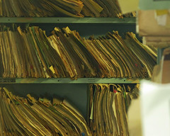 """Patient records can include emergency room reports, operative reports, specialist consultation reports, test results, discharge summaries and more.  """" Paper files of medical records """" by  Newtown graffiti  is licensed under  CC BY 2.0"""