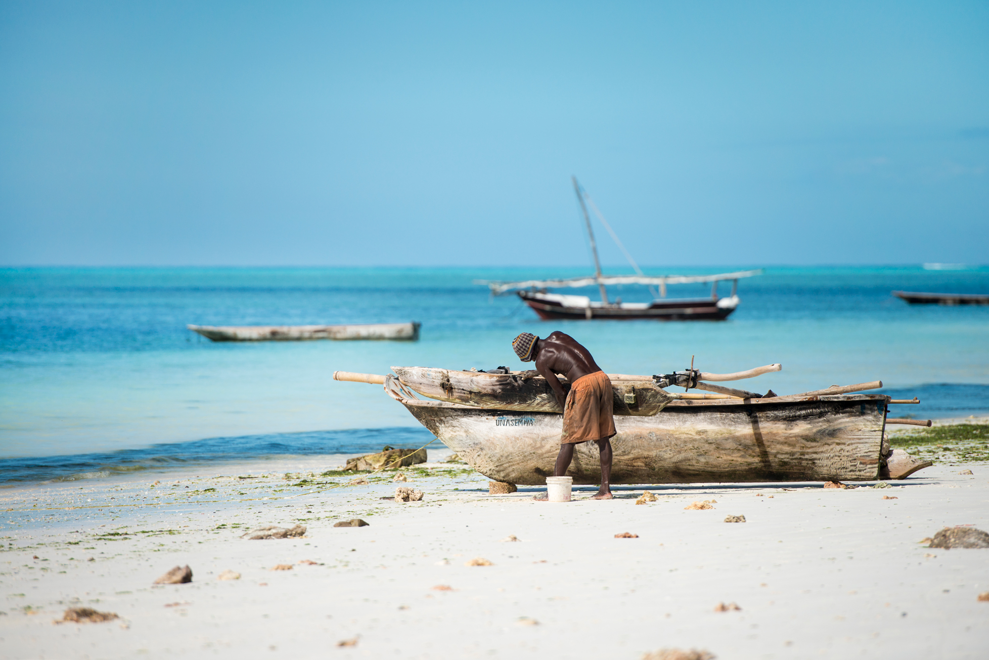 fisherman-with-boat-in-zanzibar-beach.jpg