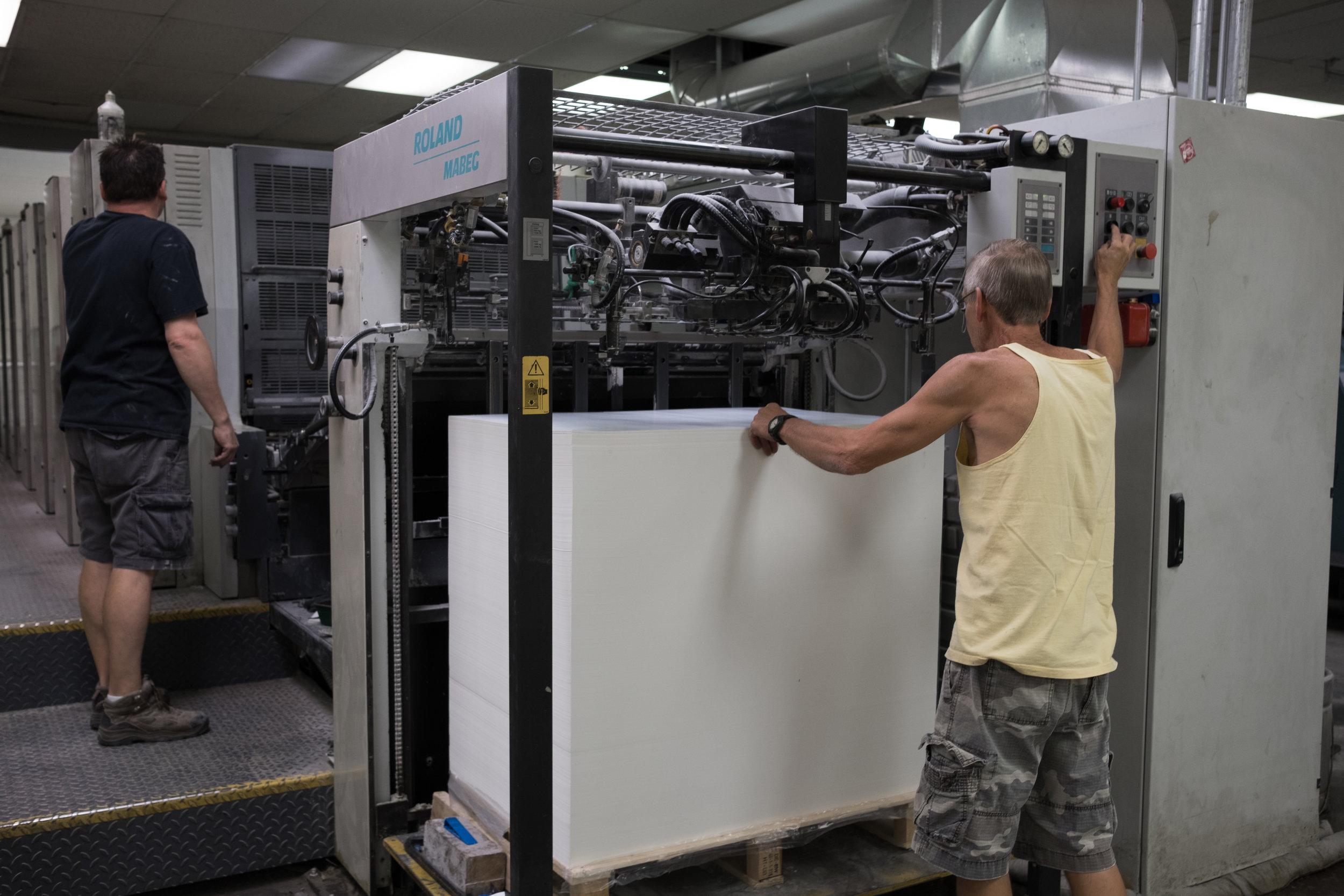 Loading paper to start a print run