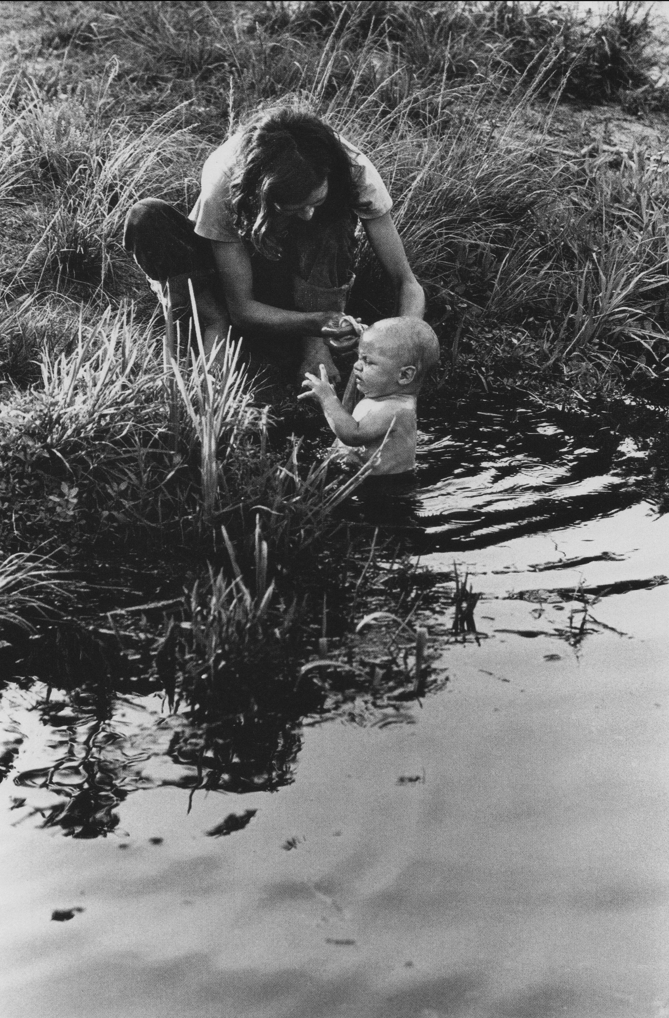 Linda bathing Shannon in irrigation canal, Loxahatchee, FL