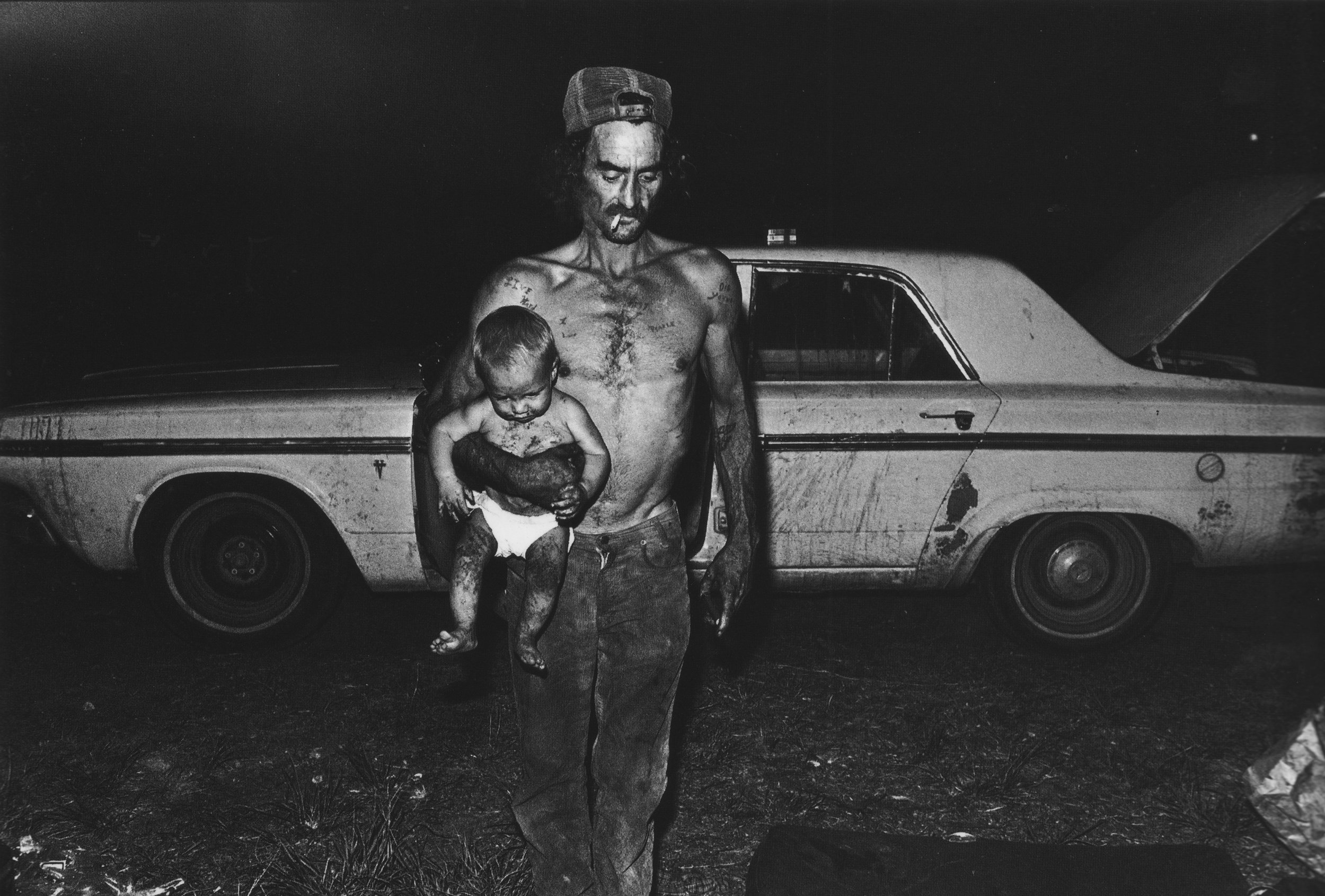 L. H. Tindal carrying son Shannon, Loxahatchee, Florida
