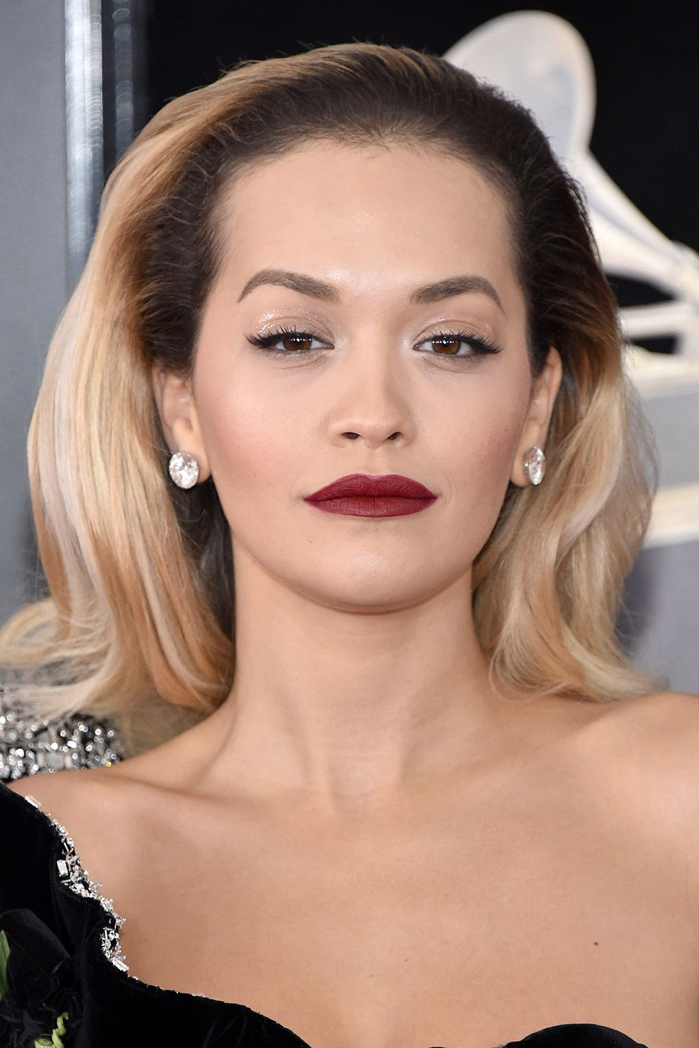 Rita Ora bare eyes gloss eye lid  red vampy lipstick makeup Grammy Ceremony 2018 .jpg
