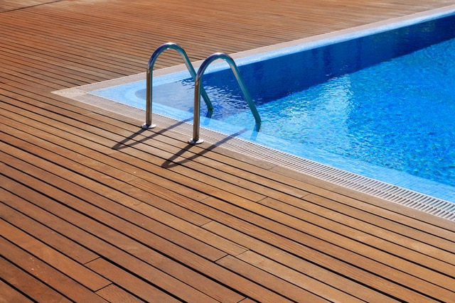 bigstock-blue-swimming-pool-with-teak-w-20146469.jpeg