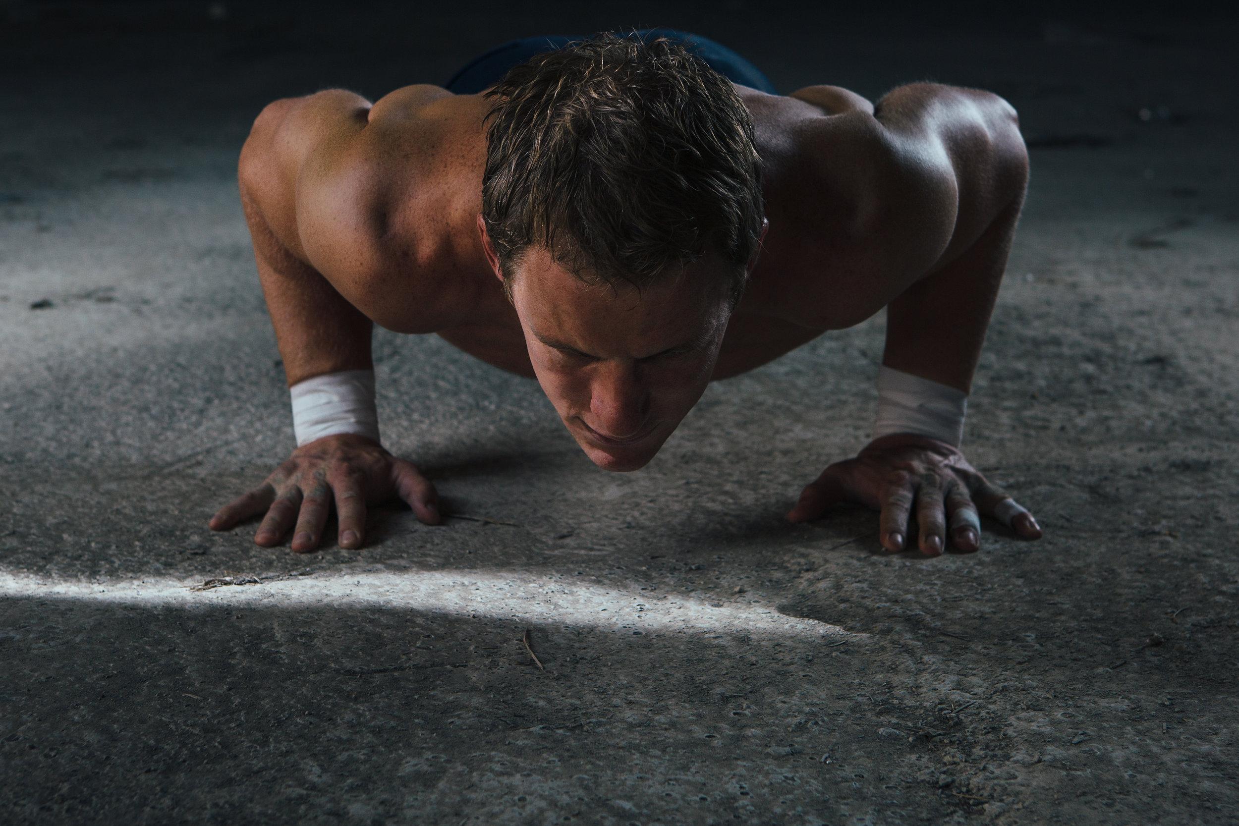 muscle-man-doing-push-ups-PEMDGLZ.jpg