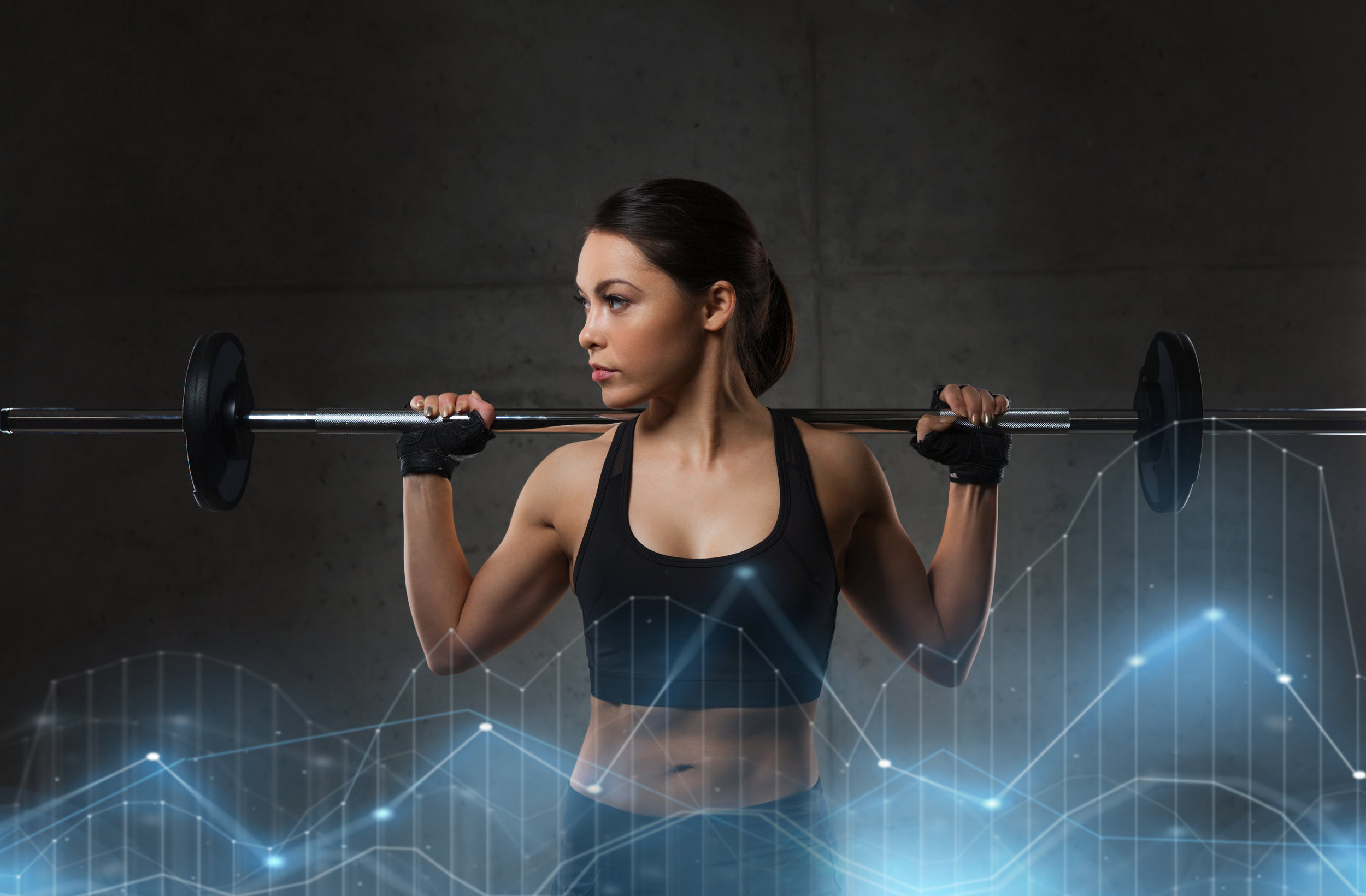 young-woman-flexing-muscles-with-barbell-in-gym-PNEZ2UA.jpg