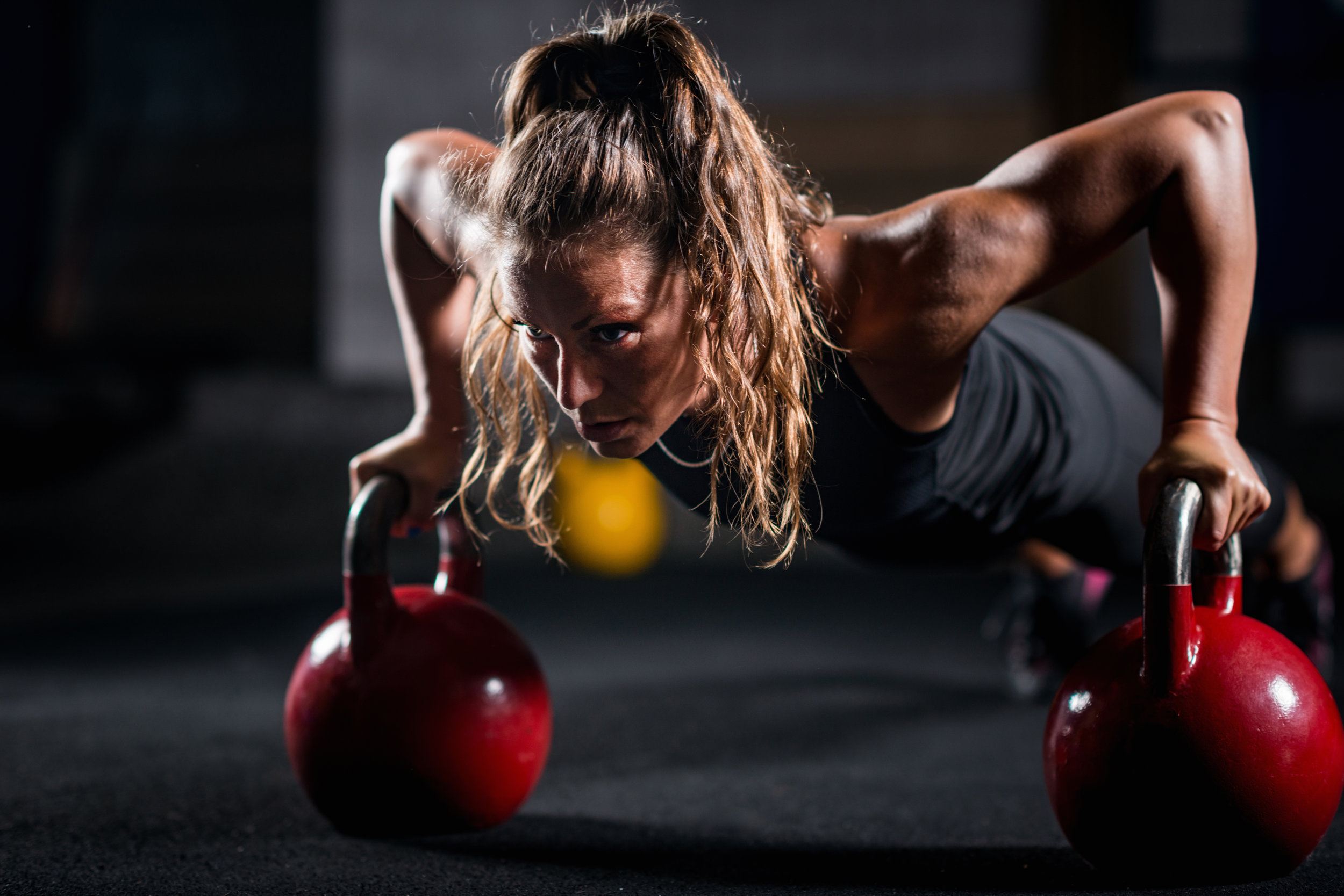 woman-athlete-exercising-with-kettlebell-PXY85YJ.jpg