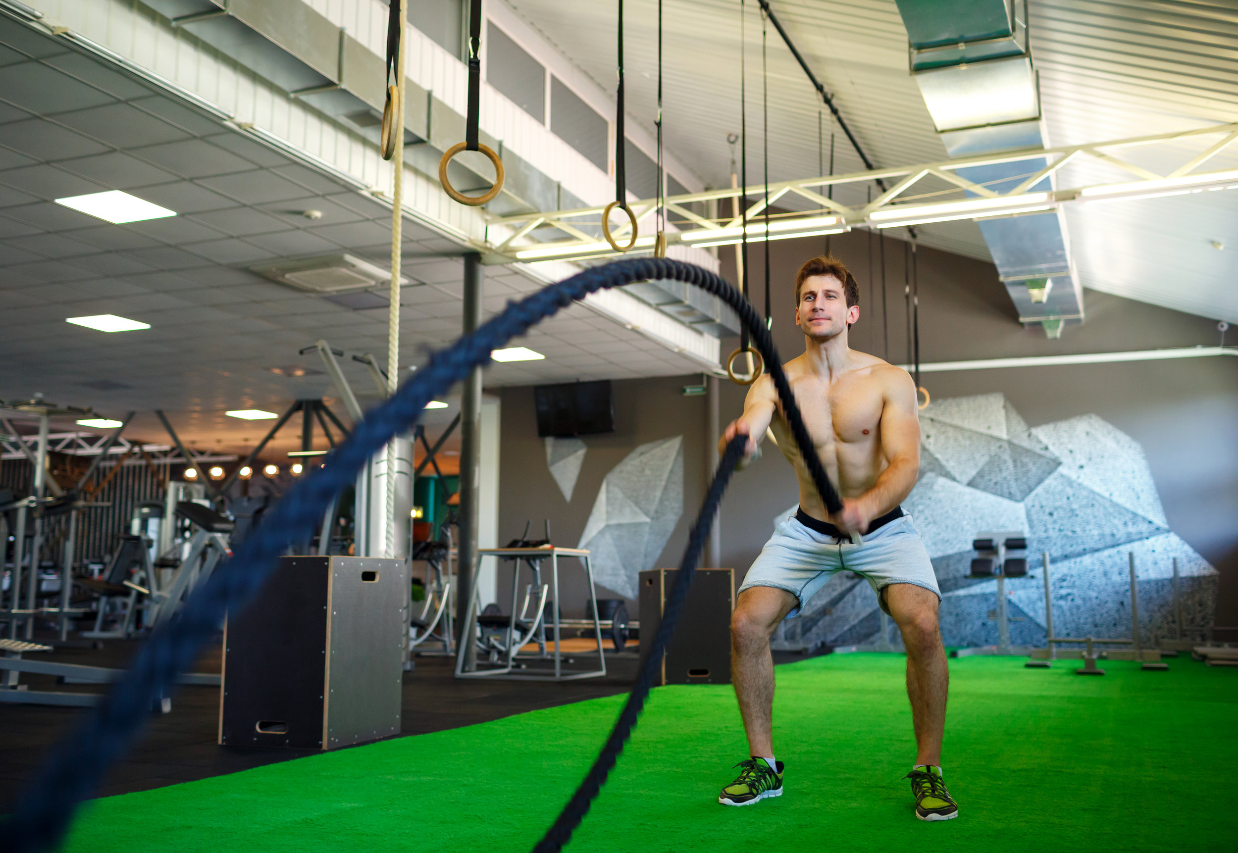 man-with-battle-rope-in-functional-training-PWBATD4.jpg