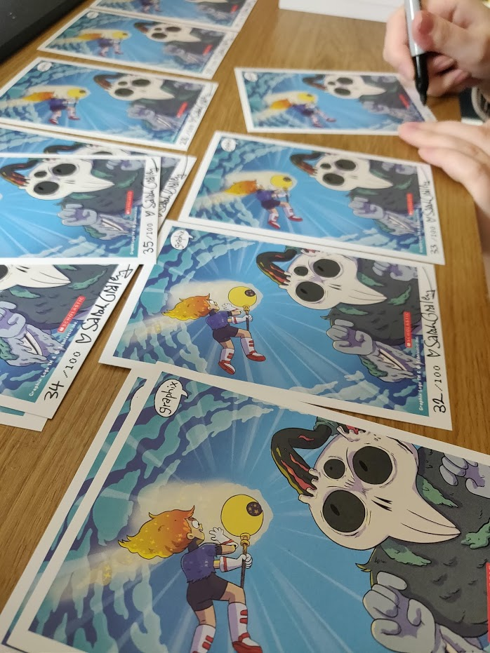 Bonus photo of me signing these ones!