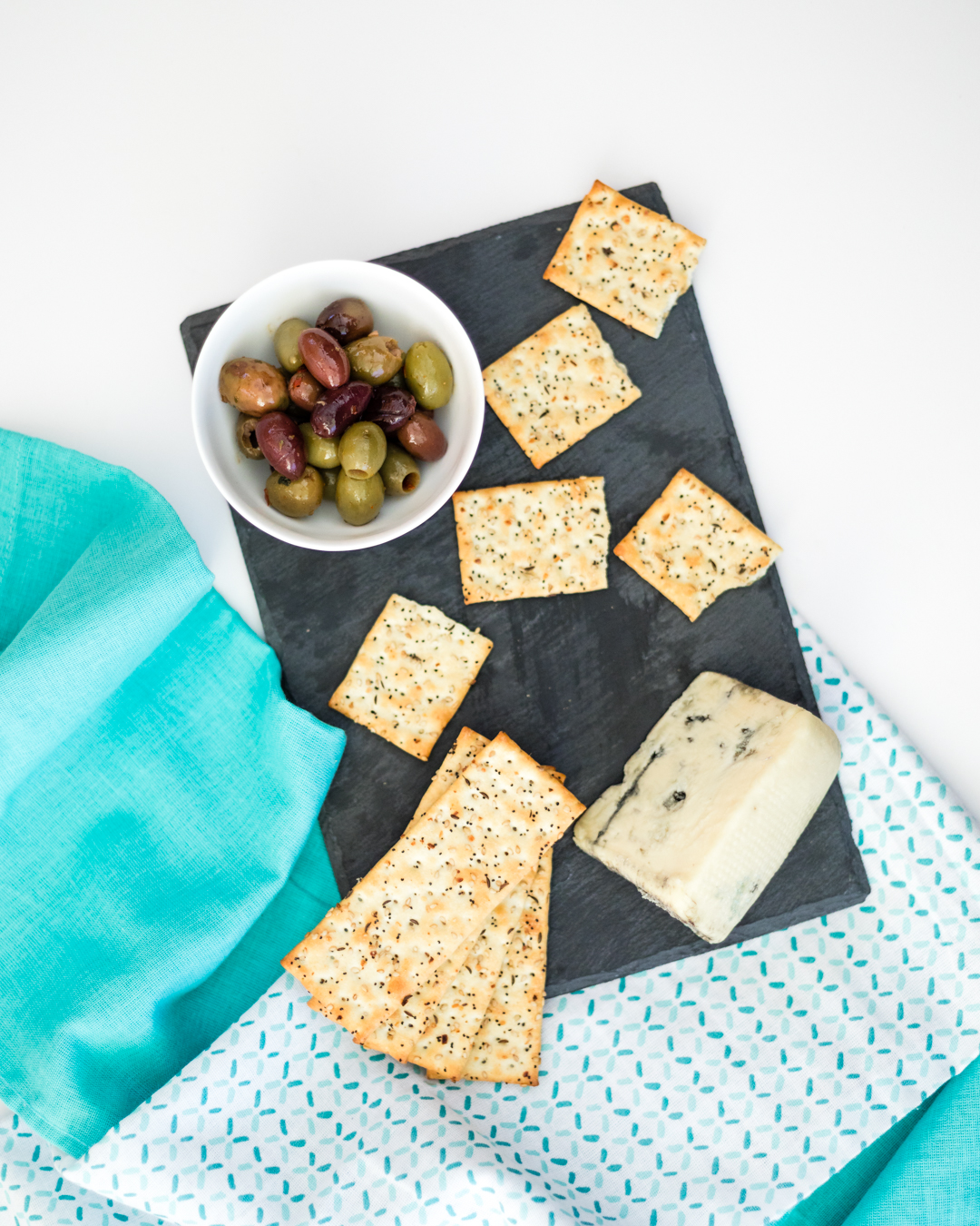 Step 3 - Arrange some flatbread crisps down the middle of your cheese platter. Depending on the size of your flatbread crisps you may wish to break them in half. In the remaining corner, arrange some additional flatbread crips.