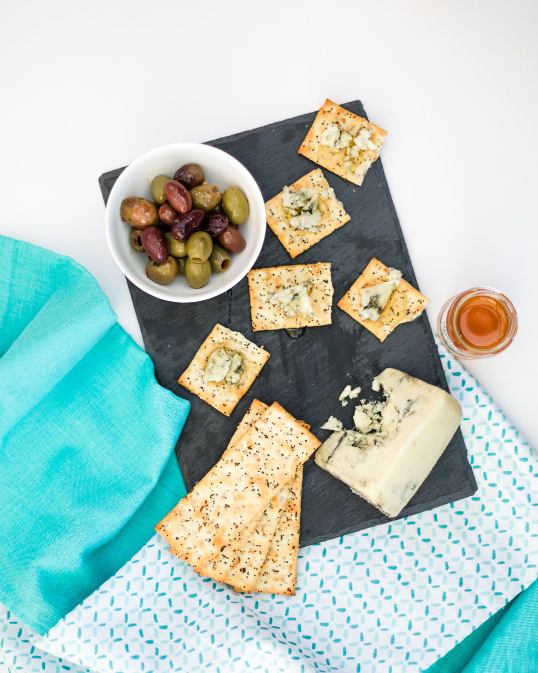 Step 4 - Spread blue cheese onto your flatbread crisps and top each with a yummy drizzle of honey.