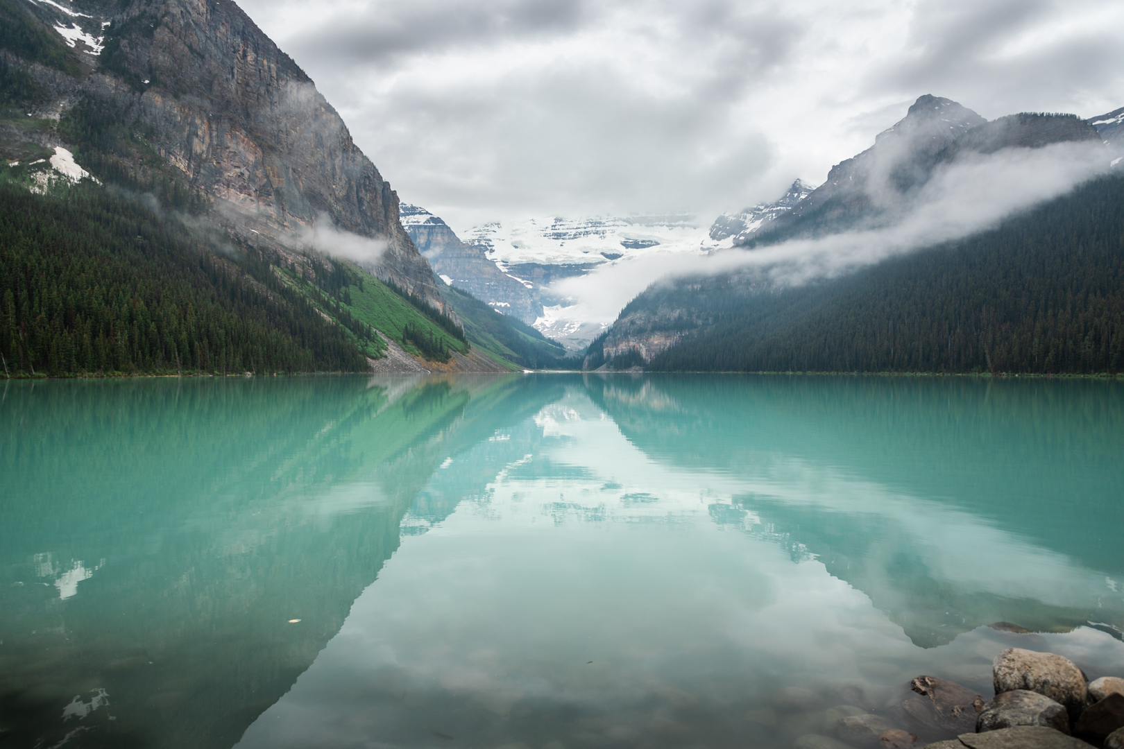 Lake Louise's beautiful aquamarine color changes with the sunlight. It's hue was a little greener as the clouds rolled in.