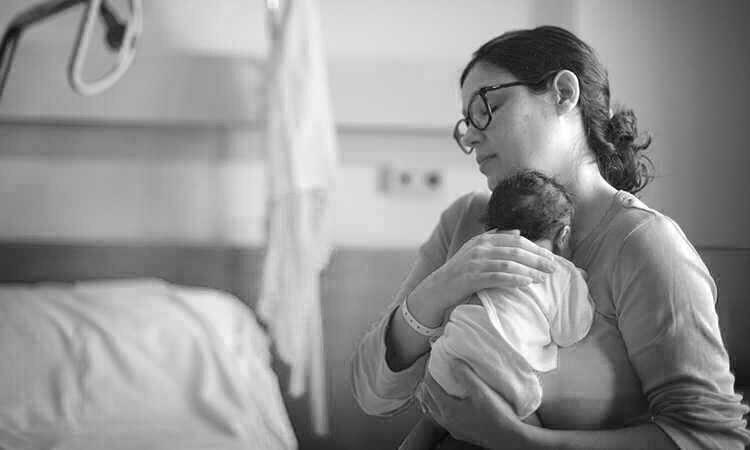 New mom holding baby.jpg