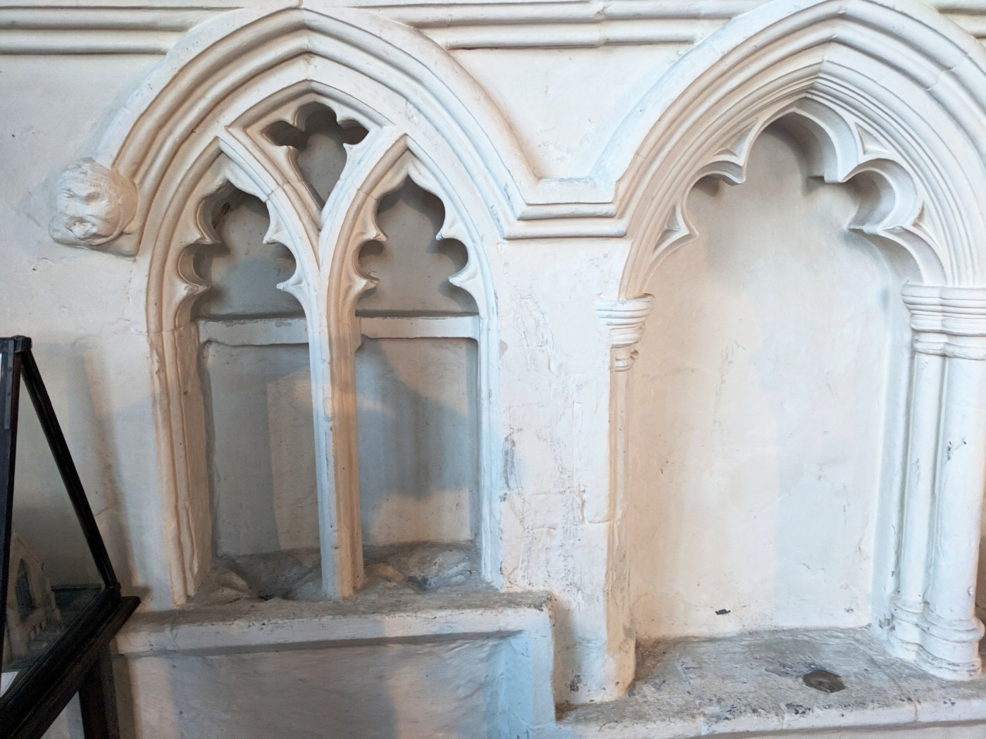 The interesting double piscina and one of the sedilia arches in the chancel