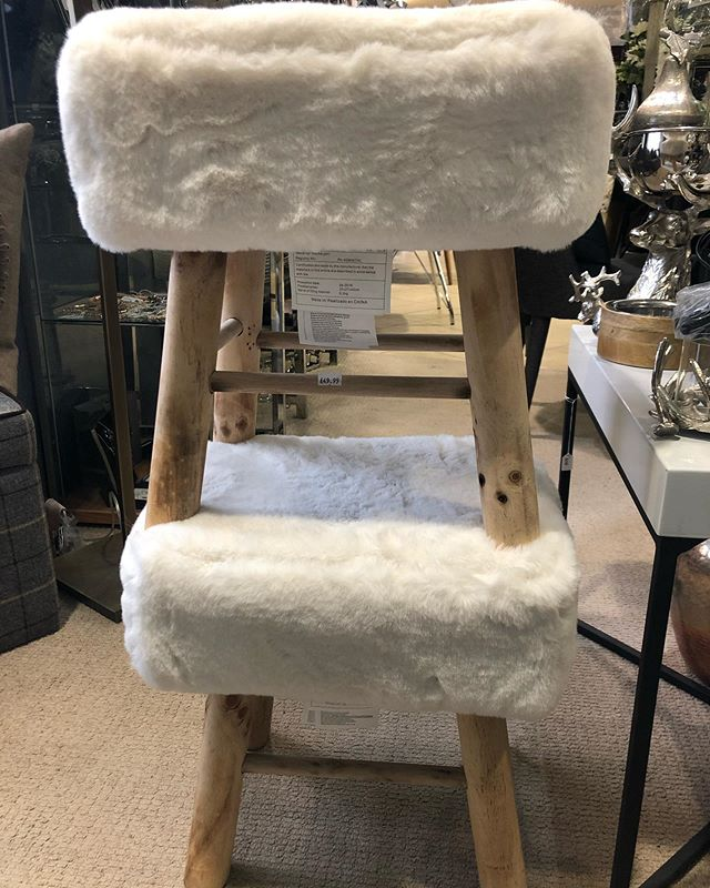 Love these! White fluffy footstools with wooden legs - less than £50. Gorgeous!