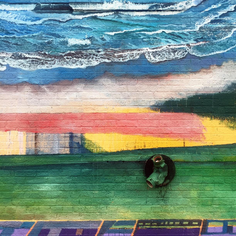 """Detail of mural """"La Plaza Del Arte Y Las Culturas"""" by Agustin Patiño."""