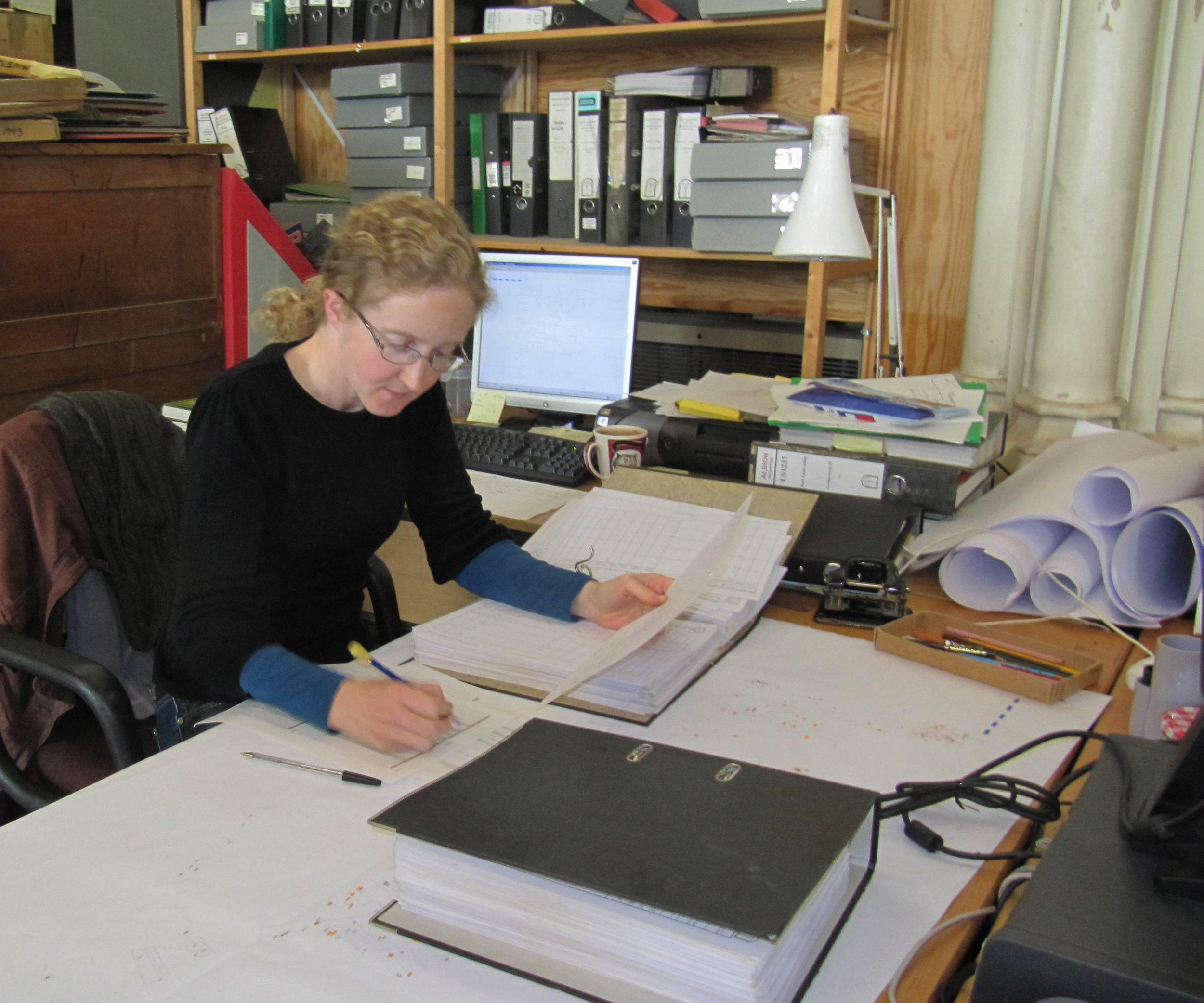 A member of the Albion Archaeology team working at the Albion Archaeology head office at St. Mary's Church, Bedford
