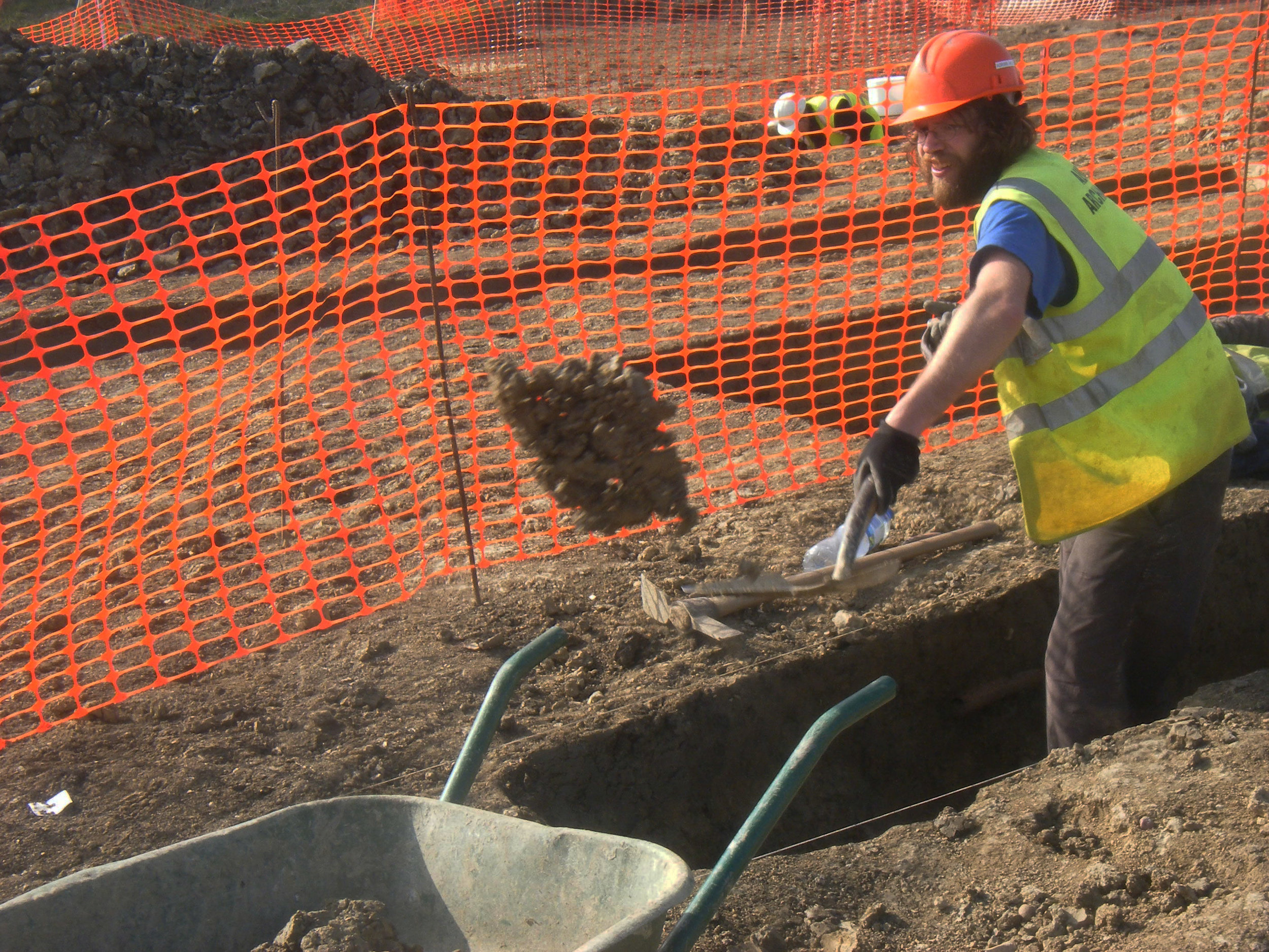 Albion Archaeology team member at work on site