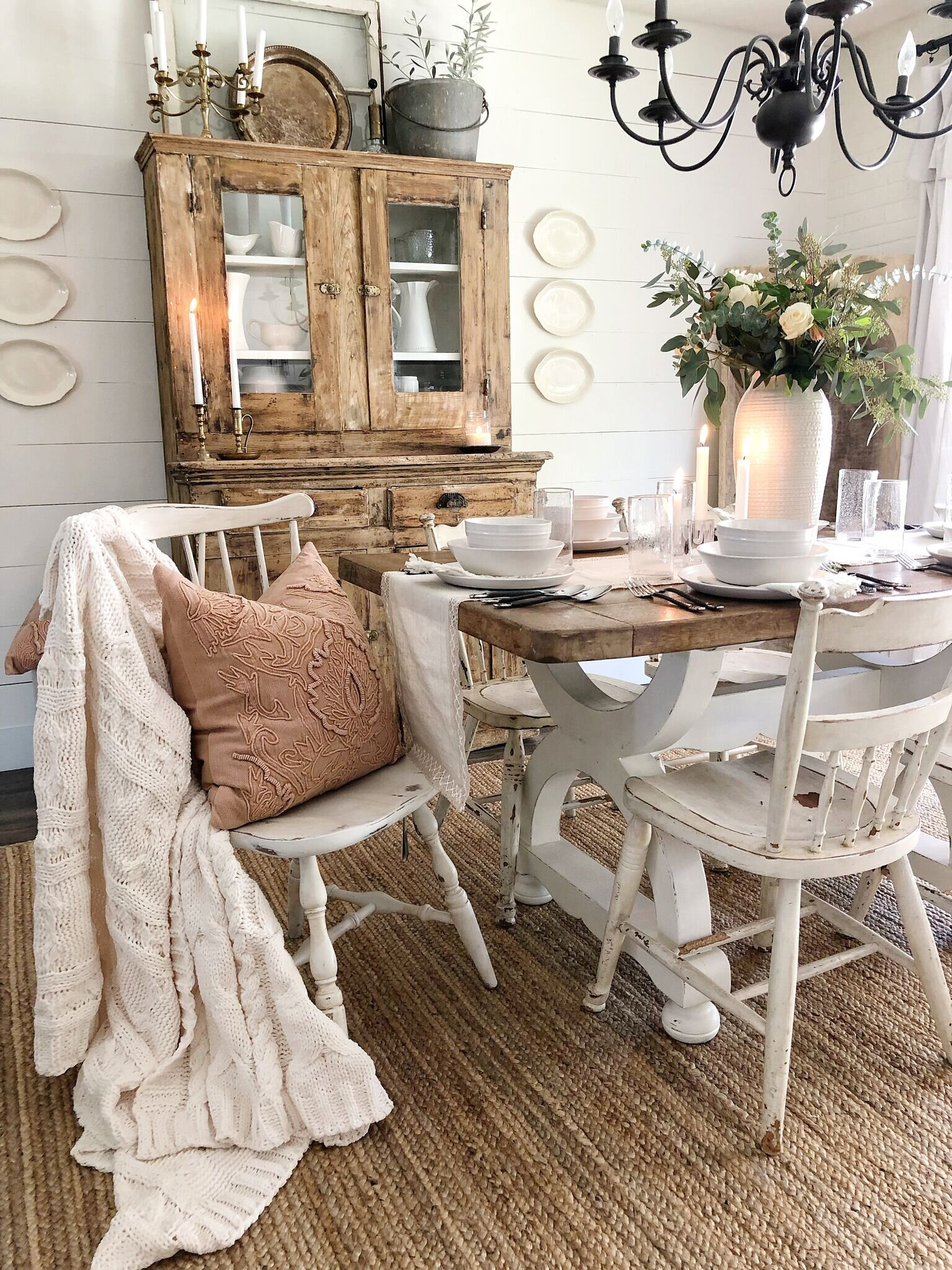 The warm colors of the pillow and rug are perfect for subtle fall decor.