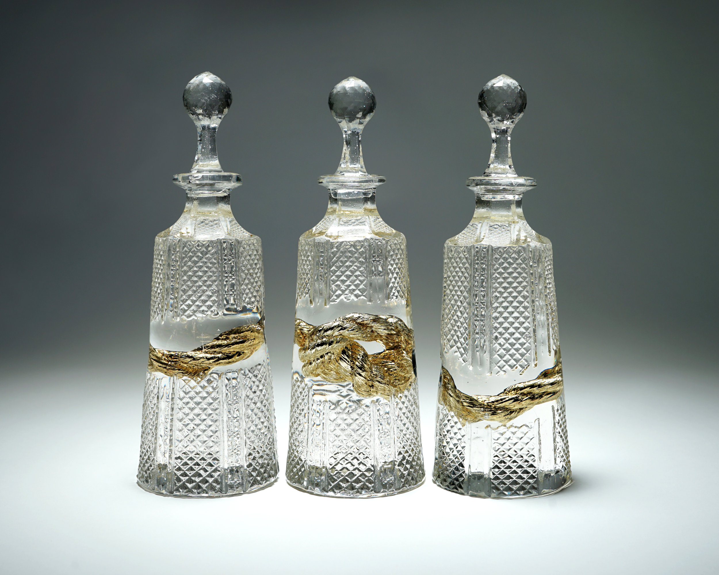 'The Golden Thread' (Hex Decanters), 2019, Cast Crystal / 24 Carat Gold Mirror, 11h x 11w x 3.50d in