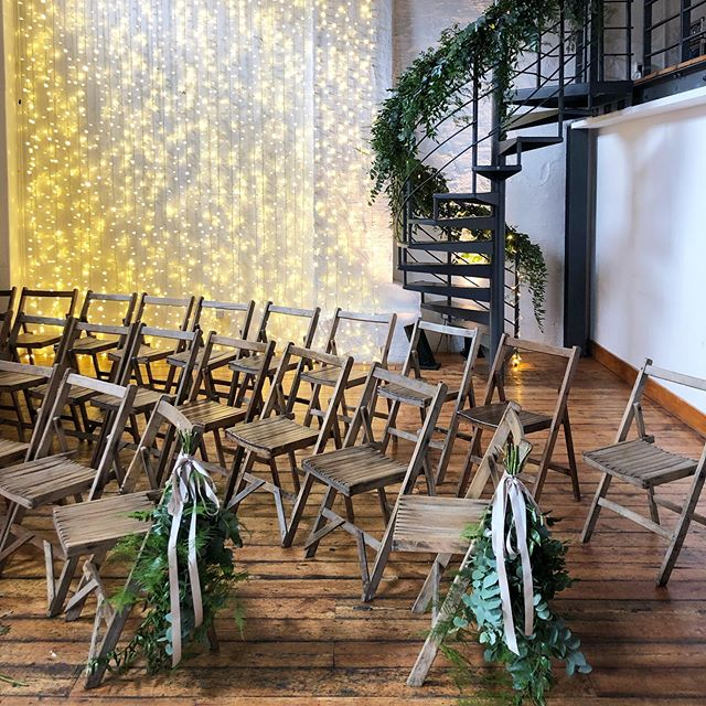Paintworks all dressed for a wedding a few weeks ago at @paintworksevents. Sometimes a staircase or foliage and large luscious bunches of foliage Tied to the chairs is all you need.