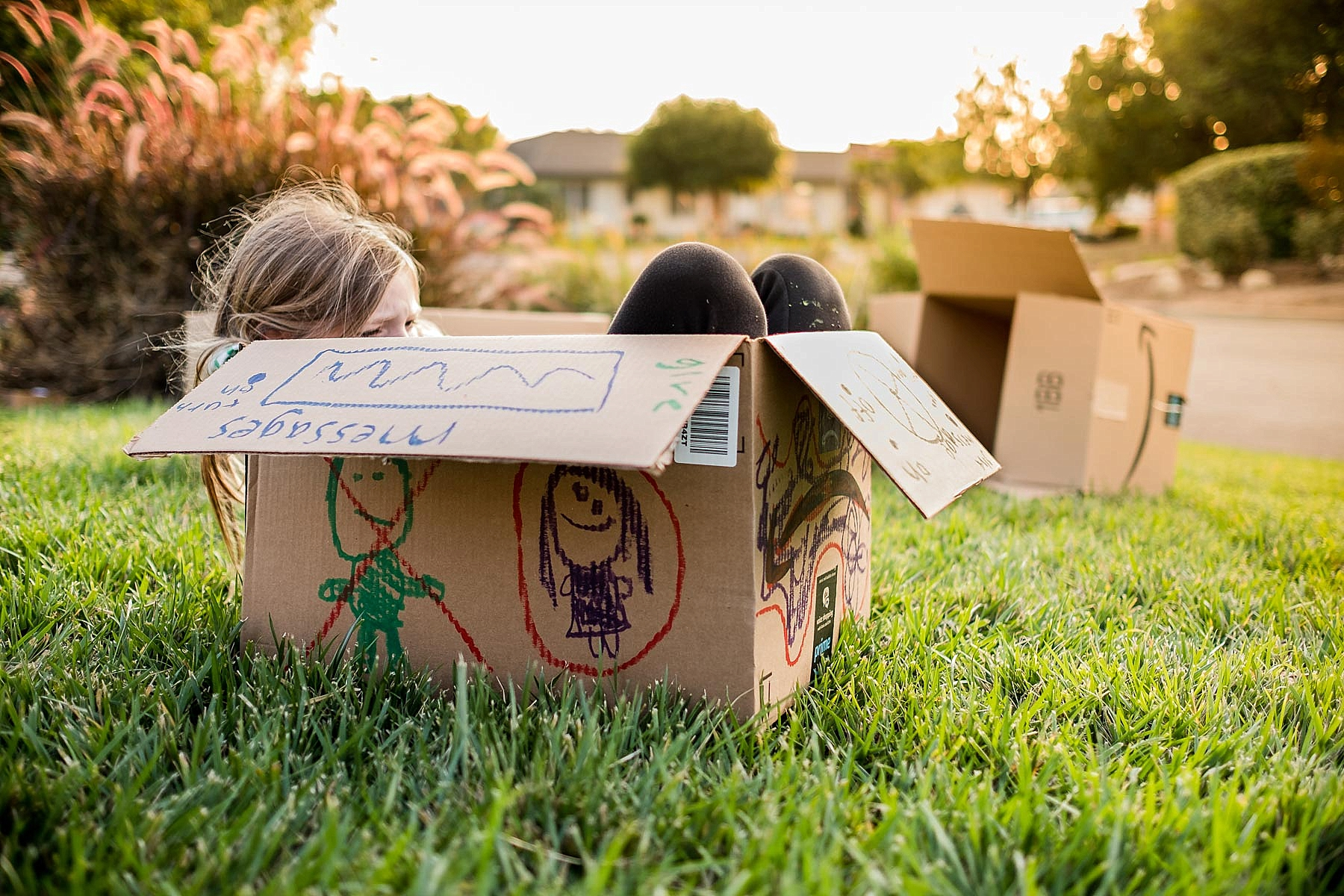 A pretty documentary photo of a girl sitting in a box during beautiful golden hour light. Taken by Erica Faith Photography in Claremont, CA