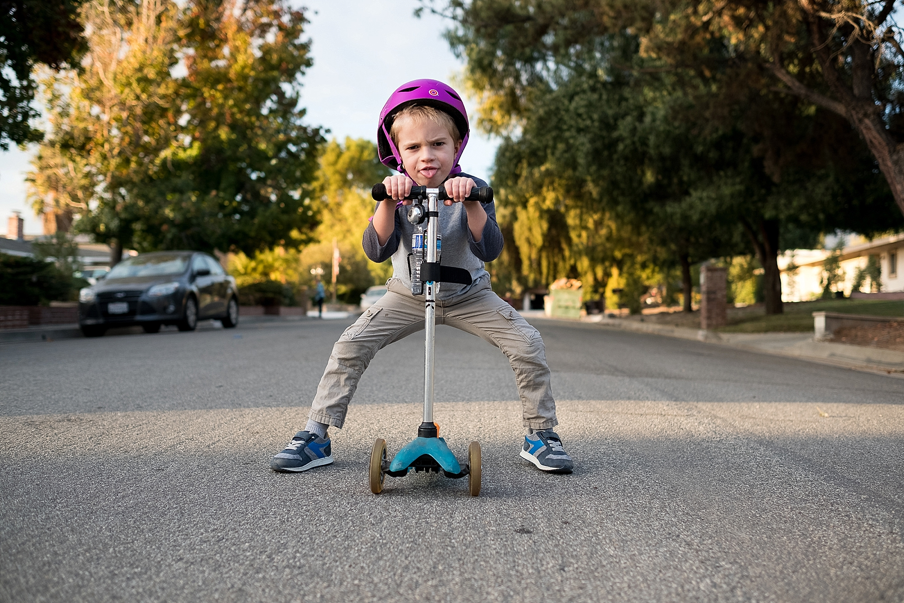 A candid documentary photo of a boy on his scooter in Claremont, CA taken by Erica Faith Walker.