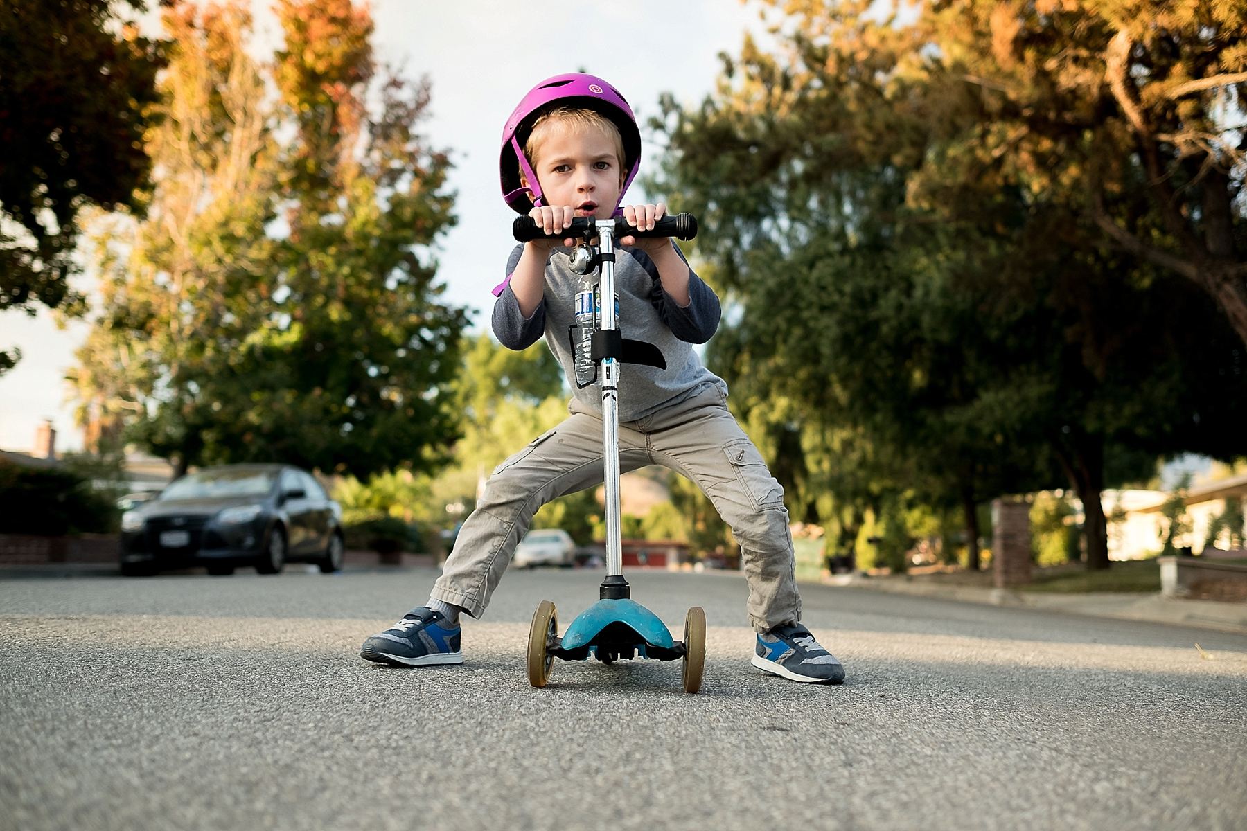 Candid and documentary photo of a boy posing with his scooter in Claremont, CA taken by Erica Faith Photography.