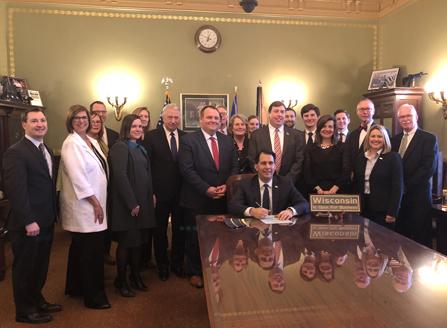 Executive Director Brad Boycks and Immediate Past President David Belman attended bill signing.